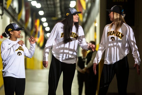 Iowa guard Tania Davis, center Megan Gustafson and forward Hannah Stewart talk in the tunnel while the Hawkeyes women's basketball team hosts a Big Ten Tournament title celebration, following the NCAA selection show, on Monday, March 18, 2019, at Carver-Hawkeye Arena in Iowa City, Iowa.