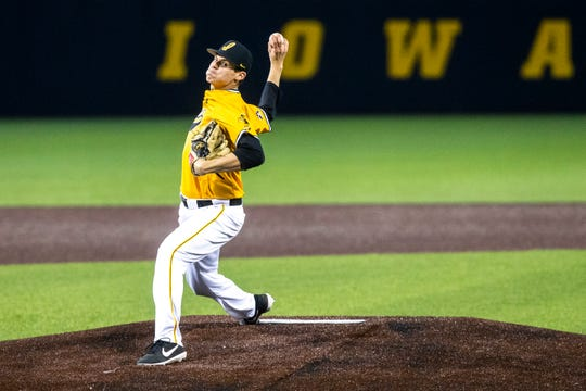Iowa's Grant Judkins (7) delivers a pitch during a NCAA non conference baseball game on Sunday, March 17, 2019, at Duane Banks Field in Iowa City, Iowa.
