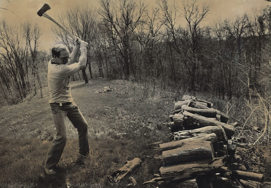 From 1983: Dan Gable chops wood on land north of Iowa City where he planned to build a new home.