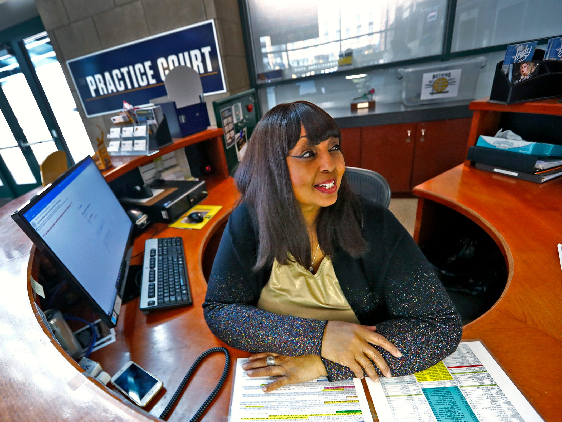 Pacers Sports & Entertainment Guest Relations Coordinator Michele Hoosier works at her desk in the lobby of Bankers Life Fieldhouse, Friday, March 15, 2019.