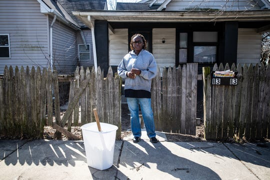 "Raniesia Gentillion stands in front of a home she and her family previously rented from one of Bert Whalen's companies. The family says Ocean Pointe Investments was made aware of the heating issues but failed to repair the furnace. ""The olive oil was solid frozen,"" said Gentillion. ""We had six electric furnaces running in the house."""
