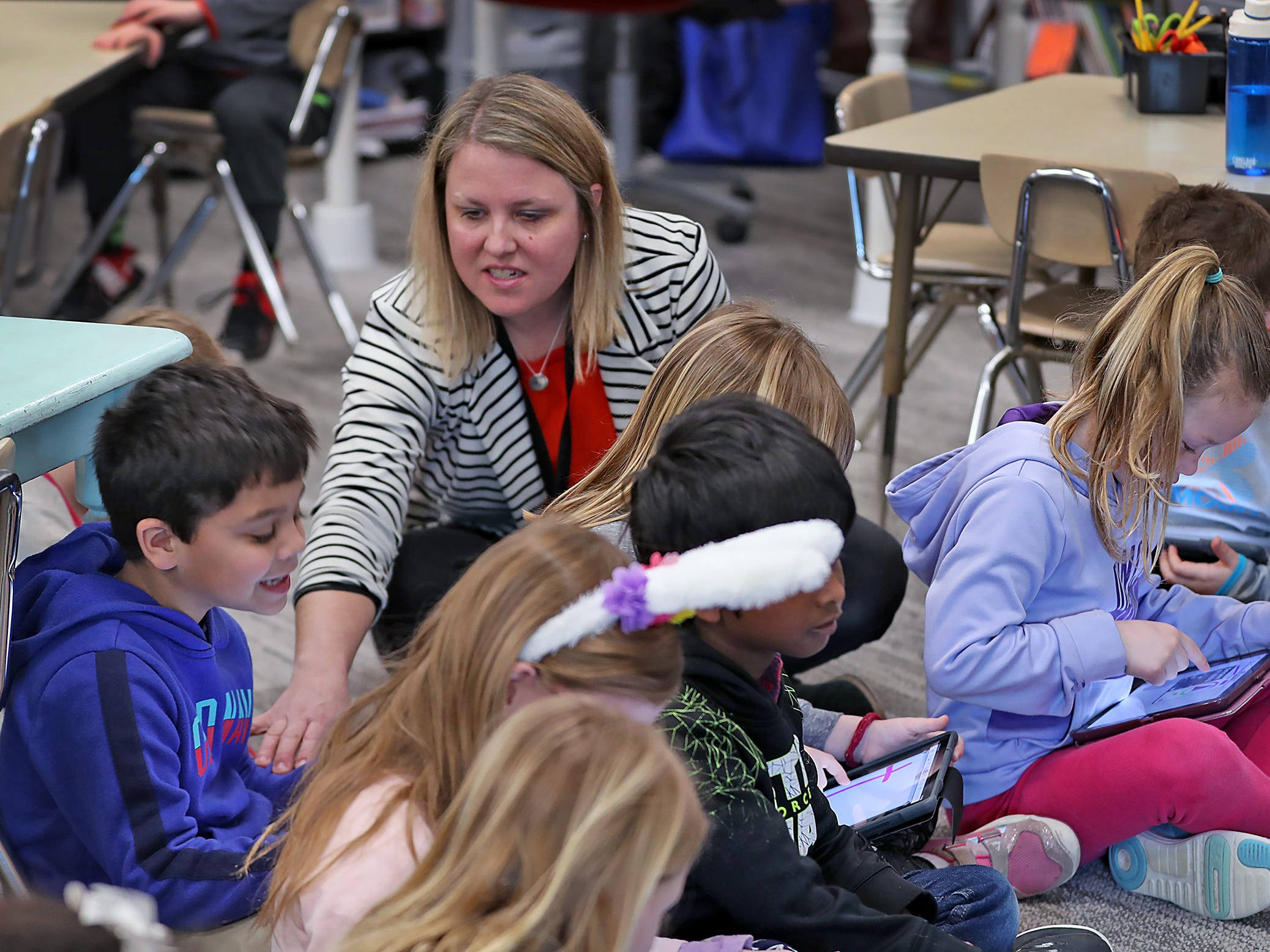 ENL certified teacher Megan McGee works with kids in a classroom at New Britton Elementary, Monday, March 18, 2019.  Hamilton Southeastern Schools were named a Title III distinguished district by the state for its successful English Learners program.
