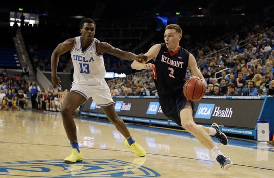 Dylan Windler drives by 2017 IndyStar Mr. Basketball Kris Wilkes in Belmont's road win at UCLA earlier this season.