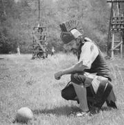 Bernard Barcio looks at a 10-pound stone during the National Catapult Contest in 1974.