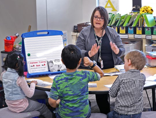 ENL certified teacher Alex Beiswanger works on reading with kids in a classroom at New Britton Elementary, Monday, March 18, 2019.  Hamilton Southeastern Schools were named a Title III distinguished district by the state for its successful English Learners program.