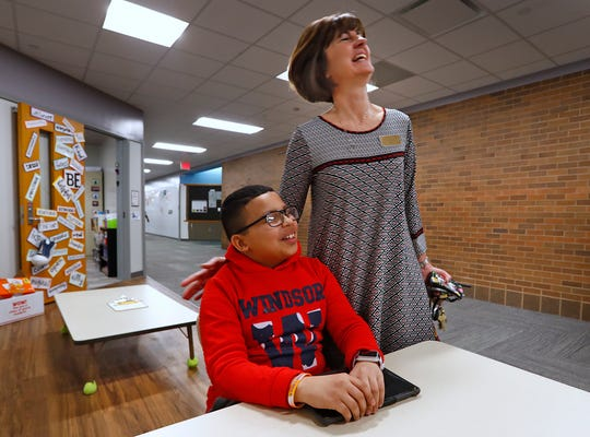 New Britton Elementary Principal Lori Mankin laughs with student Takieddine Bouzar, Monday, March 18, 2019.  Hamilton Southeastern Schools were named a Title III distinguished district by the state for its successful English Learners program.