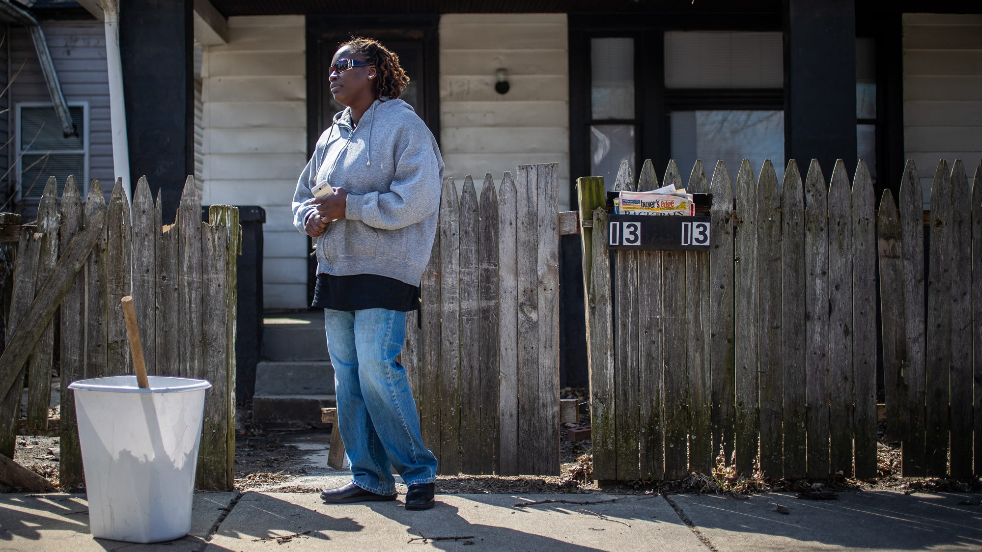 "Raniesia Gentillion talks about the home she and her family previously rented, located at 1313 Eugene Street in Indianapolis, on Monday, March 18, 2019. Gentillion says she contacted the property management company, Oceanpointe, more than two dozen times to take care of multiple issues. ""The main response was, 'We know what you're going through. We got your maintenance request. We got 800 other properties that have the same issues,'"" said Gentillion. ""My husband, my son, myself, we're in the kitchen washing up where we're supposed to be cooking and eating at."""