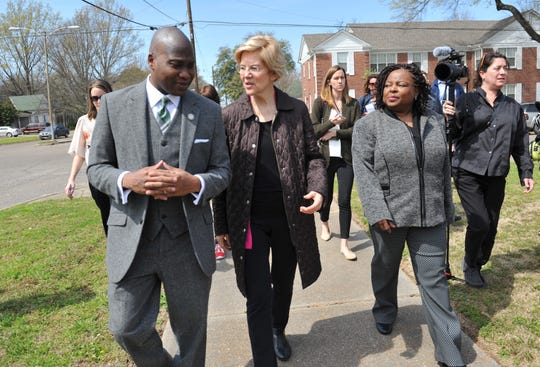 Presidential candidate Sen. Elizabeth Warren, D-Mass., and Greenville Mayor Erick Simmons, left, discuss the progress Greenville has made with housing issues and how much still needs to be done during a walking tour of the city, Monday, March 18, 2019. With them is Mable Starks, second from right, former CEO of Mississippi Action for Community Education. While in Greenville, Warren promoted the affordable housing bill she's rolled out as part of her 2020 campaign for presidency.
