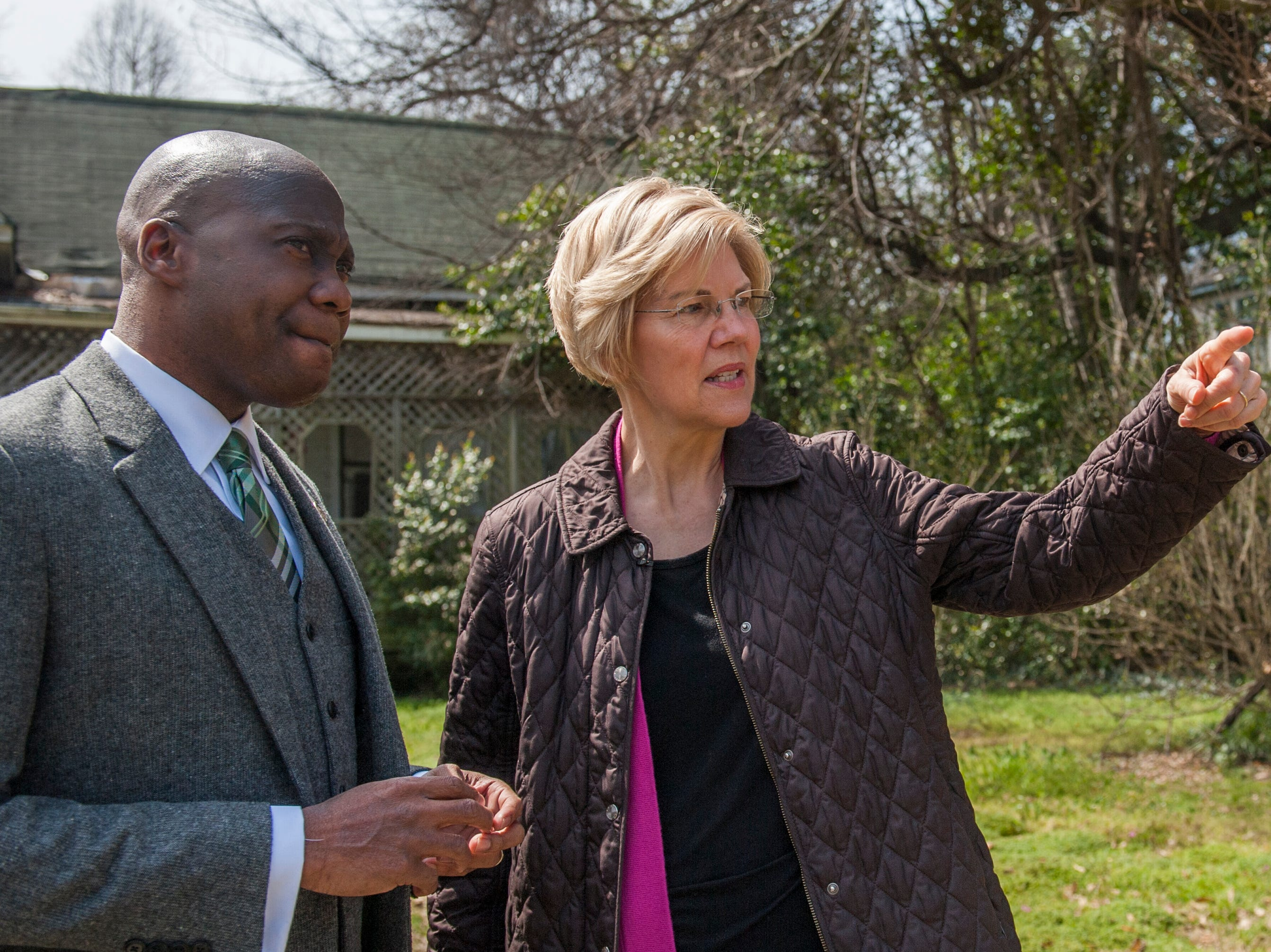 Presidential candidate Sen. Elizabeth Warren, D-Mass., and Greenville Mayor Erick Simmons discuss the progress Greenville has made with housing issues and how much still needs to be done as they walk tree-lined Central Street, once filled, but now left with vacant houses and empty lots. While in Greenville , Monday, March 18, 2019, Warren promoted the affordable housing bill she's rolled out as part of her 2020 campaign for presidency.