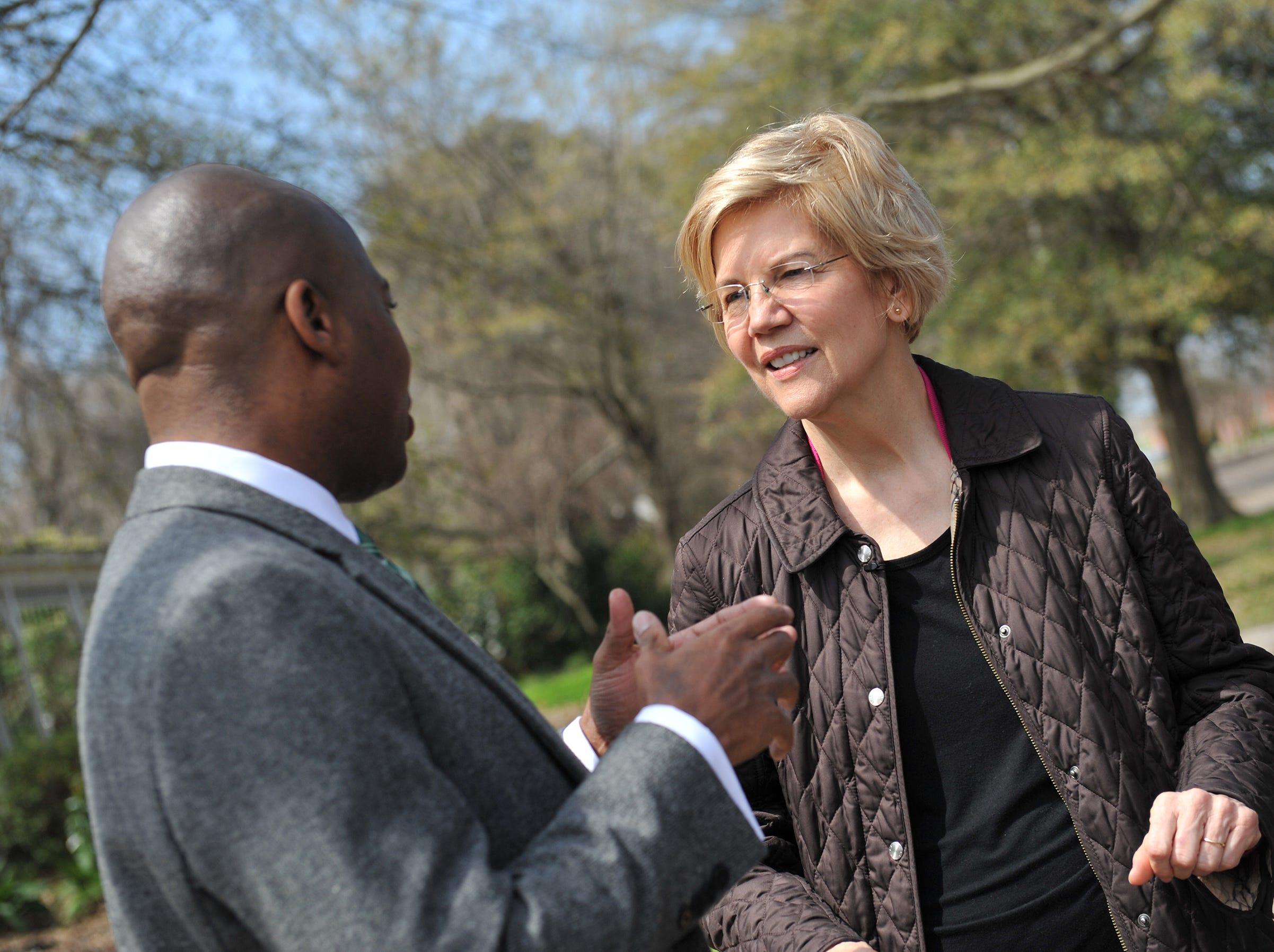 During a Monday, March 18, 2019, walking tour of Central Street in Greenville, Presidential candidate Sen. Elizabeth Warren, D-Mass., lis tens to Mayor Erick Simmons as he discusses the progress the city has made with housing issues and how much still needs to be done. Central Street, once filled, is now left with vacant houses and empty lots. While in Greenville, Warren promoted the affordable housing bill she has rolled out as part of her 2020 campaign for presidency.