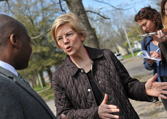 Presidential candidate Sen. Elizabeth Warren, D-Mass., and Greenville Mayor Erick Simmons discuss the progress Greenville has made with housing issues and how much still needs to be done as they walk tree-lined Central Street, once filled, but now left with vacant houses and empty lots. While in Greenville , Monday, March 18, 2019, Warren promoted the affordable housing bill she has rolled out as part of her 2020 campaign for presidency.