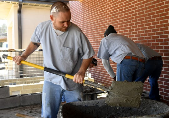 TDOC inmate Dana Flannery mixes cement outside of the West Tennessee Regional Training Center and Madison County Sheriff's Office, Monday, March 18. Flannery is a part of the National Center for Construction Education and Research certification program.