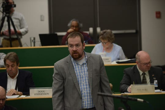Commissioner Jason Compton (D-10) speaks during the Madison County Commission meeting March 18.