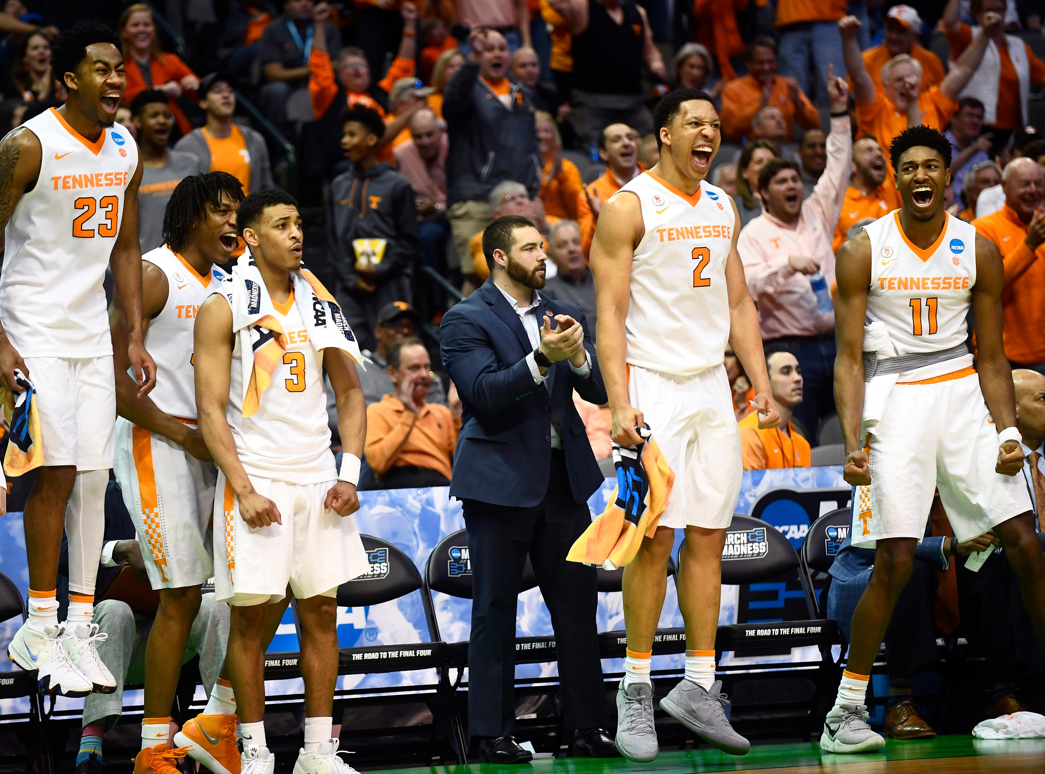 The Tennessee bench celebrates a slam dunk by Tennessee guard Jalen Johnson (13) during the NCAA Tournament first round game between Tennessee and Wright State at American Airlines Center in Dallas, Texas, on Thursday, March 15, 2018.