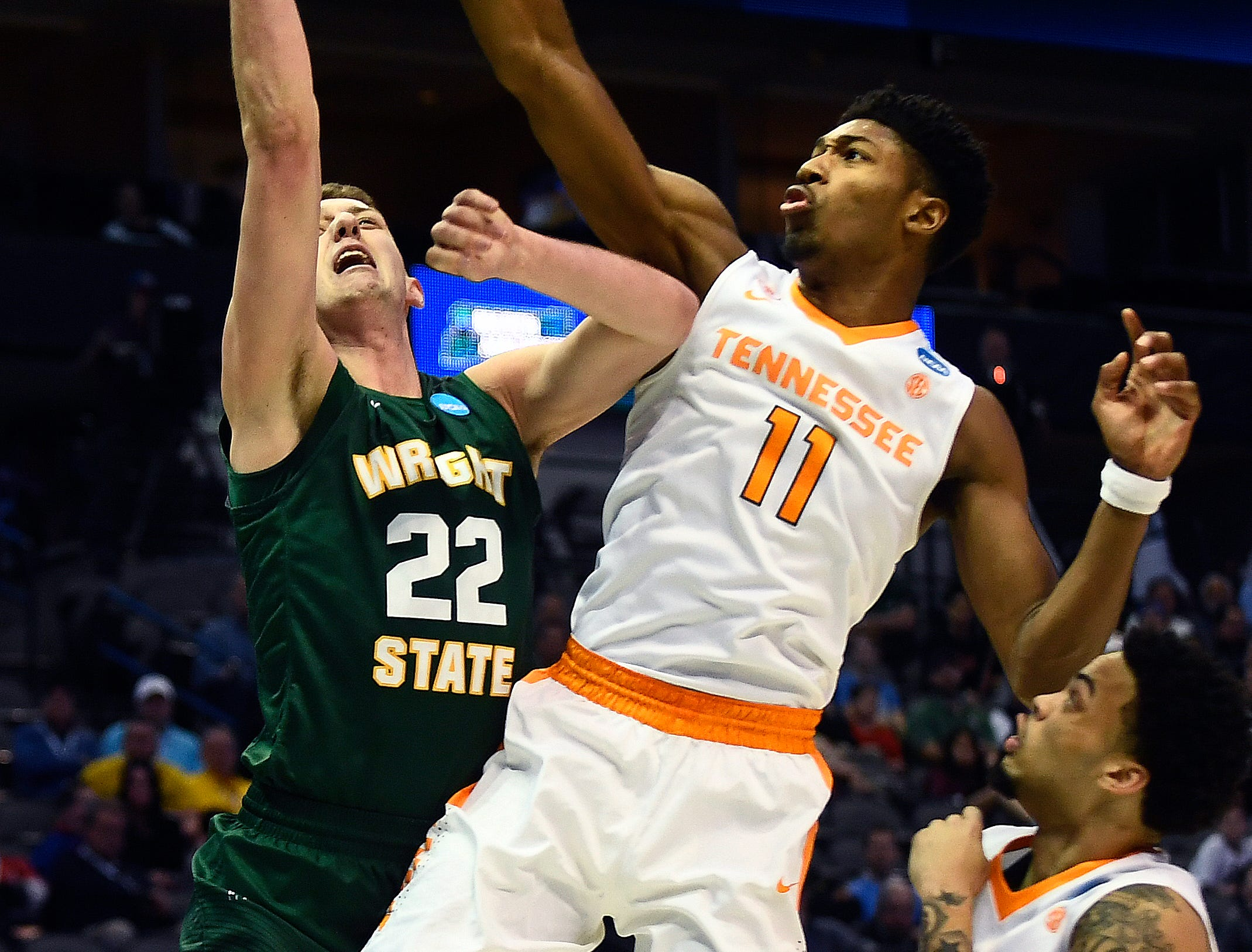 Tennessee forward Kyle Alexander (11) blocks a shot by Wright State center Parker Ernsthausen (22) during the NCAA Tournament first round game between Tennessee and Wright State at American Airlines Center in Dallas, Texas, on Thursday, March 15, 2018.