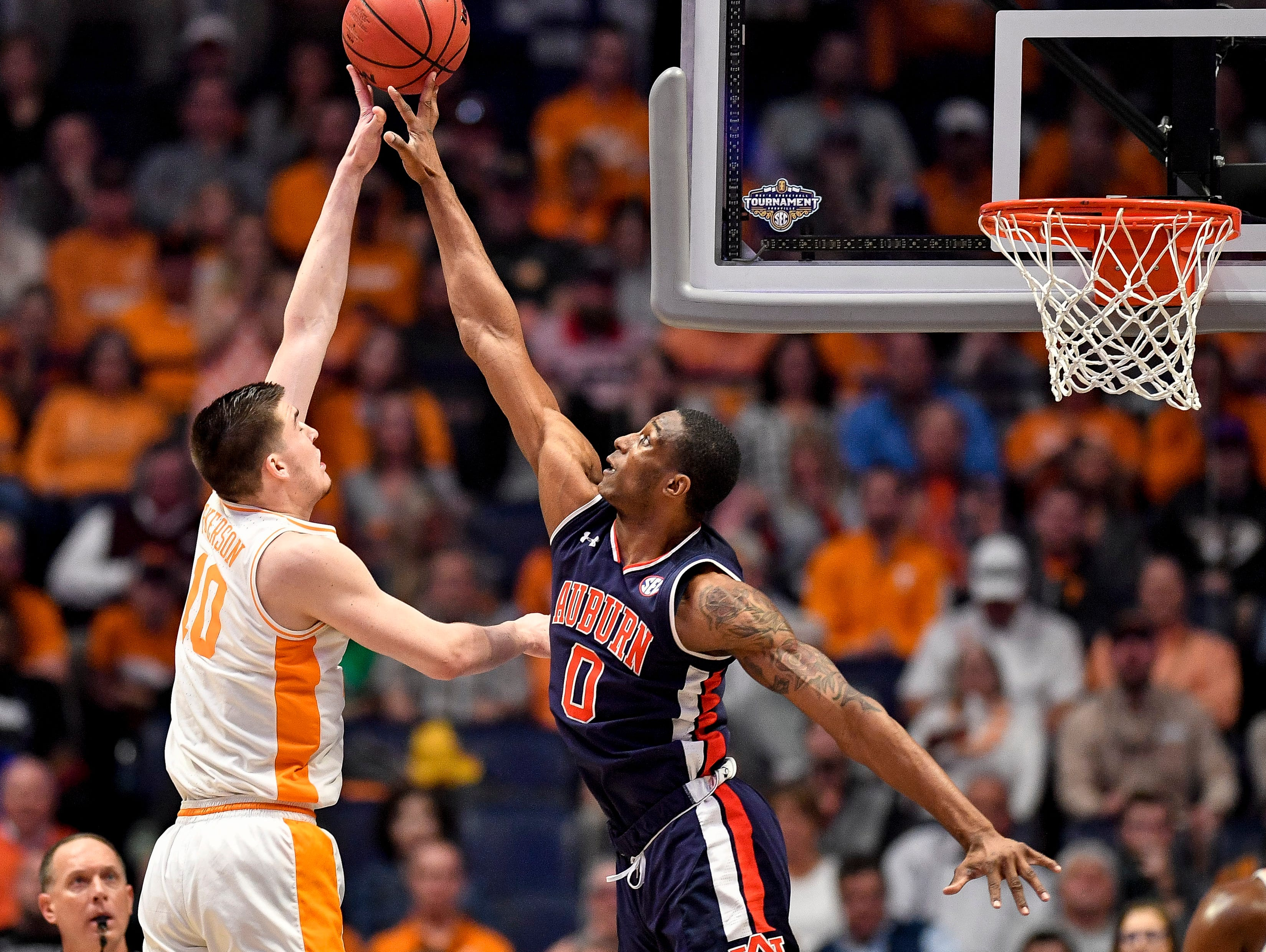 Auburn forward Horace Spencer (0) blocks Tennessee forward John Fulkerson (10) during the first half of the SEC Men's Basketball Tournament championship game at Bridgestone Arena in Nashville, Tenn., Sunday, March 17, 2019.