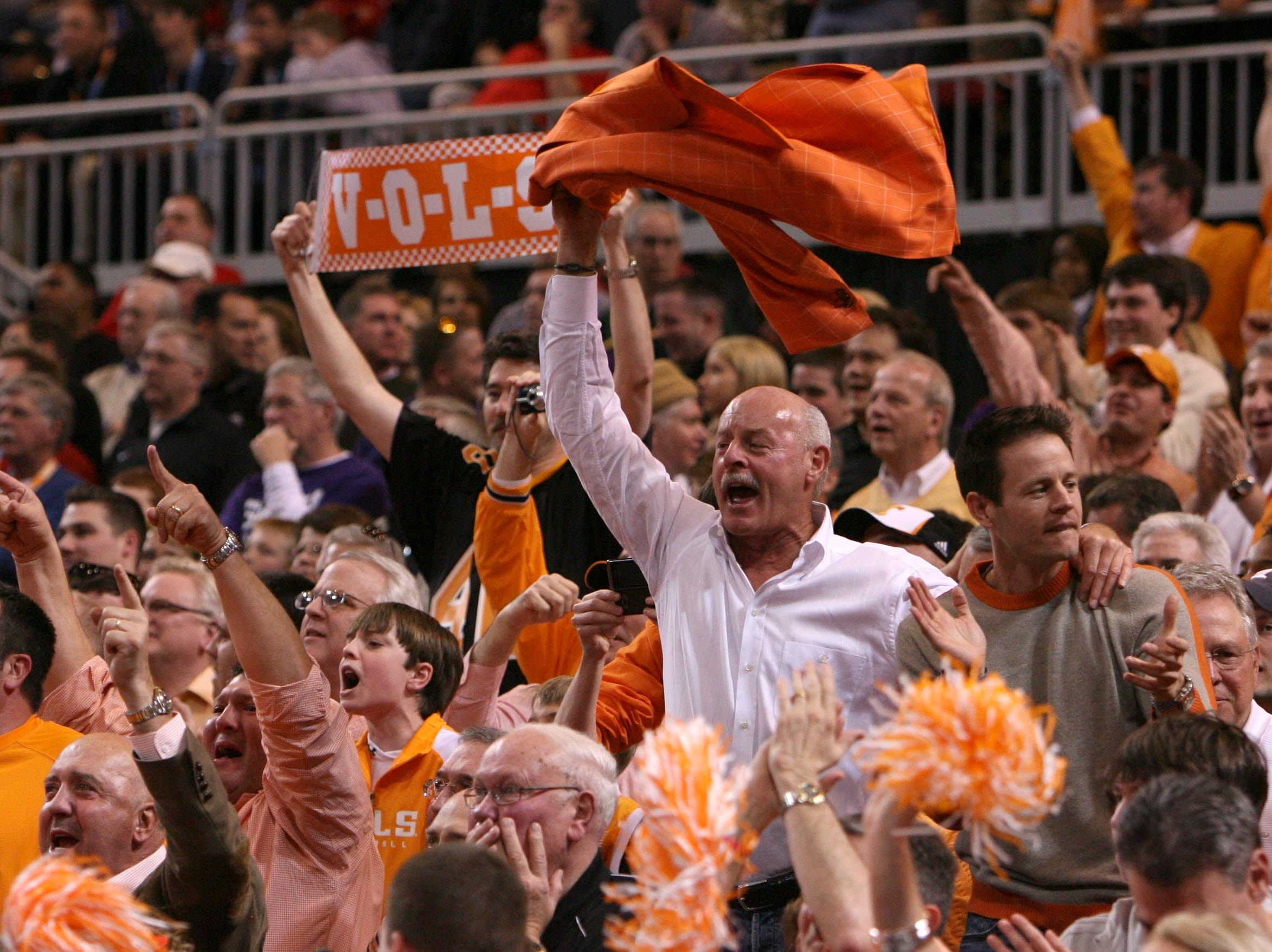 Tennessee fans cheer on the Vols after they defeated Ohio State during the NCAA tournament Sweet Sixteen at the Edward Jones Dome in St. Louis, Mo., Friday, Mar. 26, 2010.