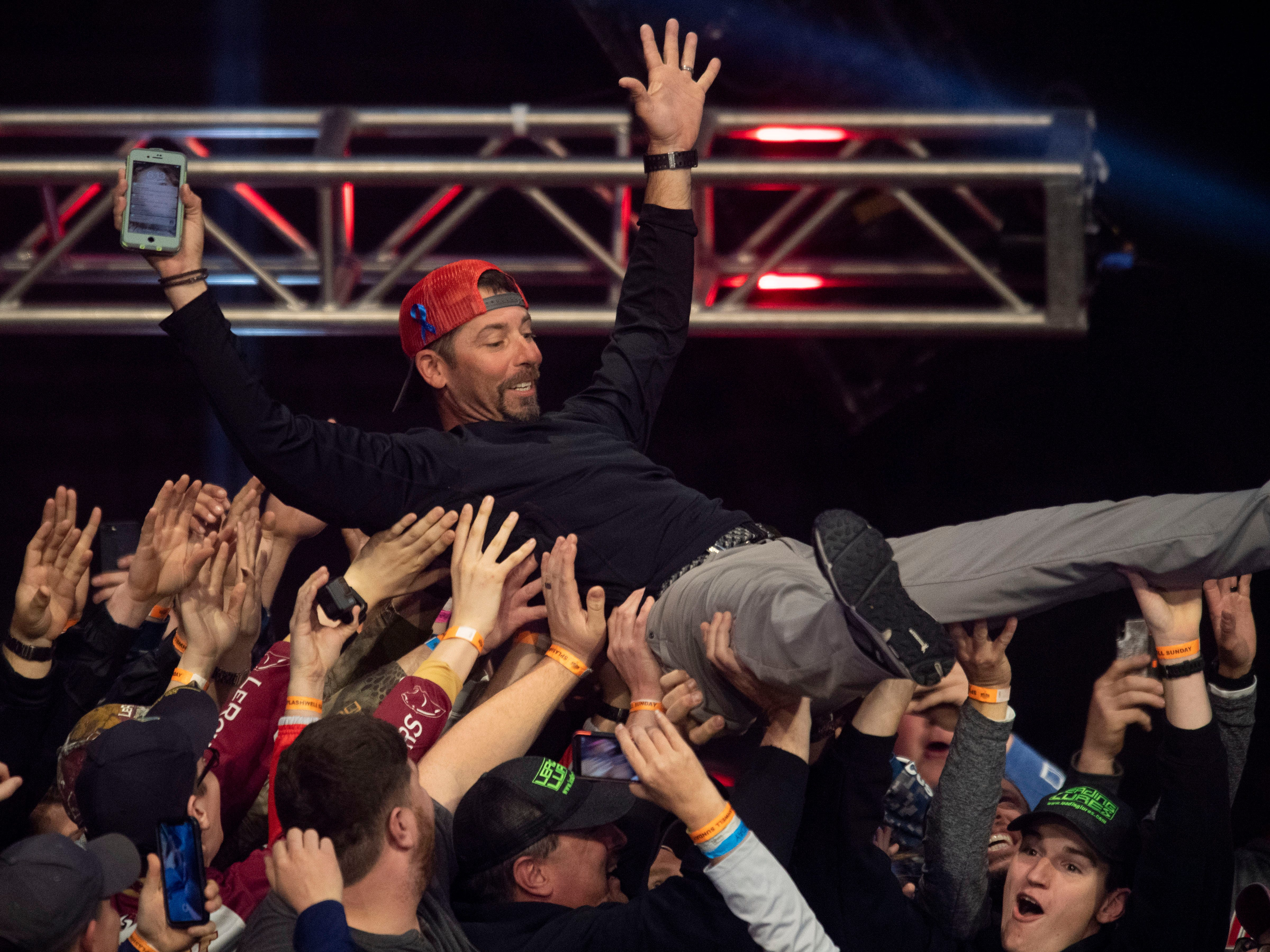 Professional fisherman Michael Iaconelli crowd surfs during the weigh-in on the last day of the Bassmaster Classic at Thompson-Boling Arena on Sunday, March 17, 2019. Iaconelli came in 4th place in the competition with a total catch weight of 42 pounds, 9 ounces.
