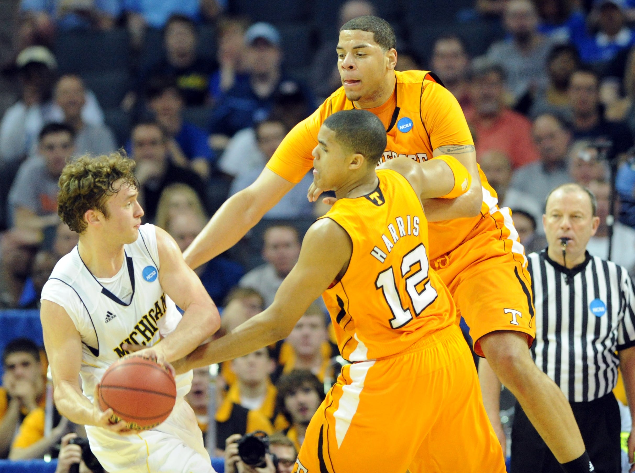 Tennessee forward Tobias Harris, center, and center Brian Williams, right, defend against Michigan forward Zack Novak as he looks for an open teammate during the second round of the NCAA Tournament at Time Warner Cable Arena in Charlotte, N.C. Friday, March 18, 2011.  Novak scored 14 points for the Wolverines during their 75-45 defeat of the Vols.