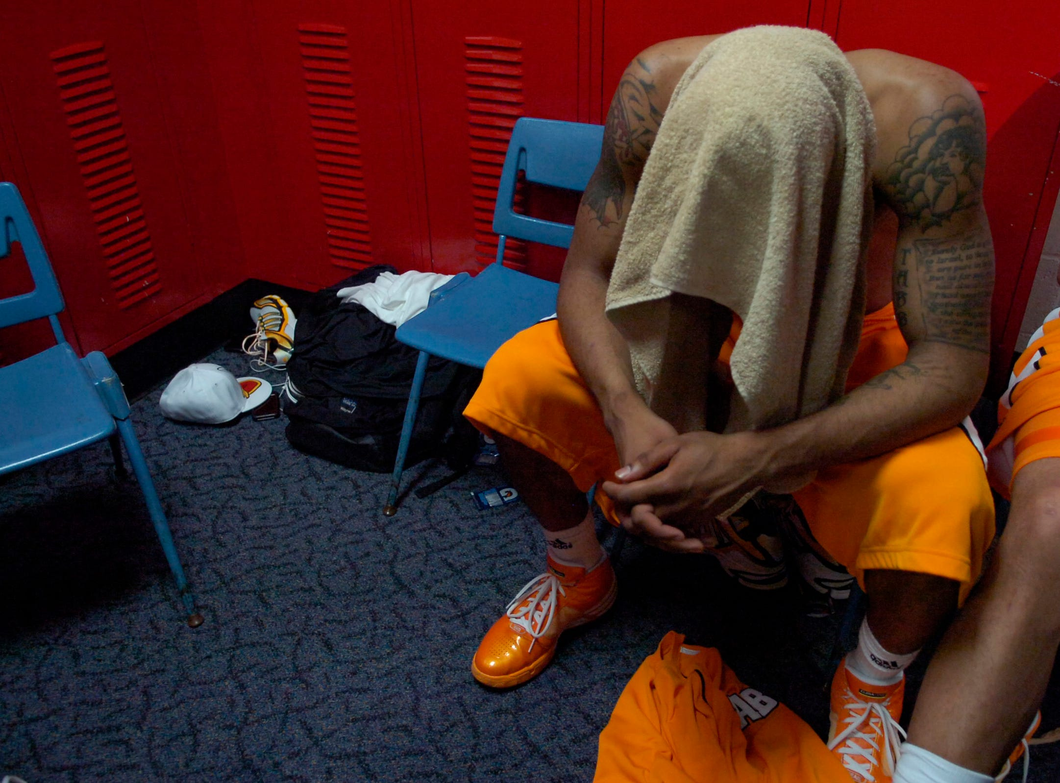 Tennessee's Josh Tabb sits in the locker room after the 77-75 loss to  Oklahoma State in the first round of the 2009 NCAA tournament in Dayton, OH on Friday, ending the Volunteers season.