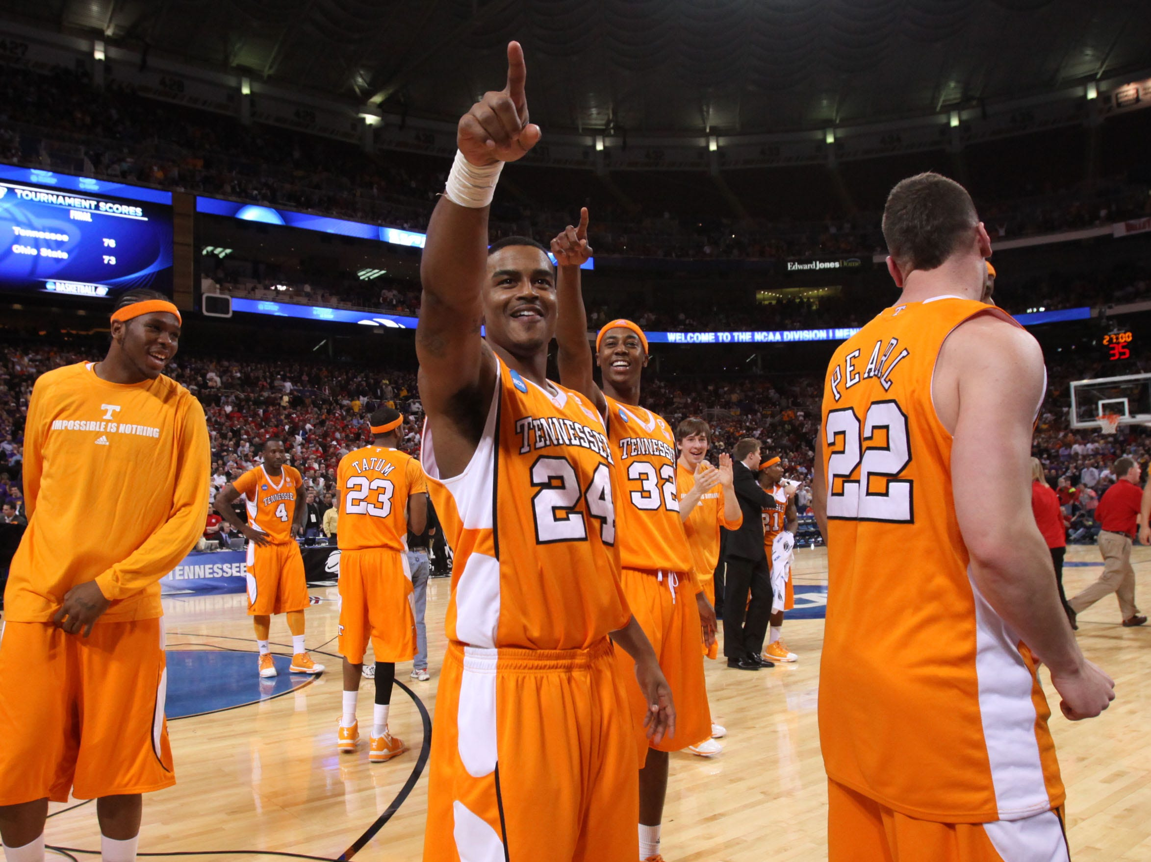 Tennessee's Josh Bone and Scotty Hopson, center, celebrate after the Vols defeated the Ohio State Buckeyes 76-73 during the NCAA tournament Sweet Sixteen at the Edward Jones Dome in St. Louis, Mo., Friday, Mar. 26, 2010.