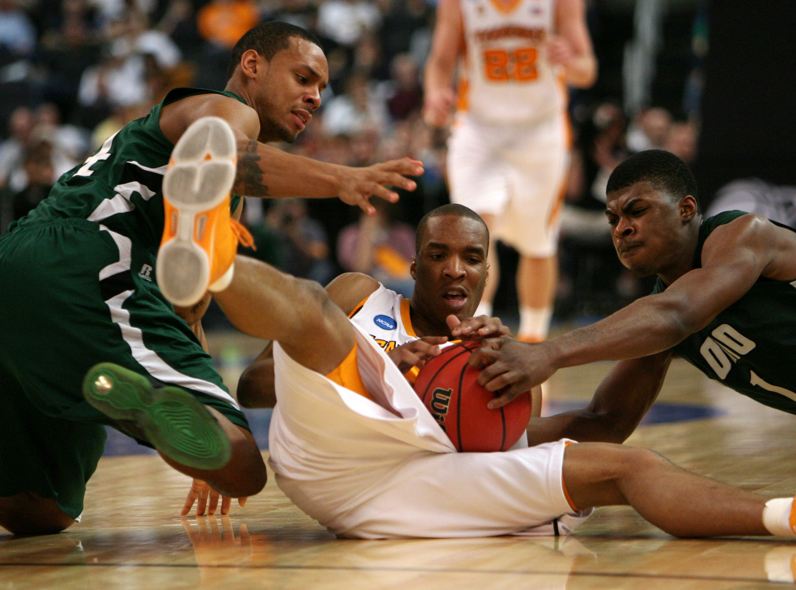 Tennessee's J.P. Prince tries to maintain control of the ball as Ohio's  Asown Sayles, left, and DeVaughn Washington defend during the second round of the NCAA tournament in Providence, R.I. Saturday, Mar. 20, 2010.