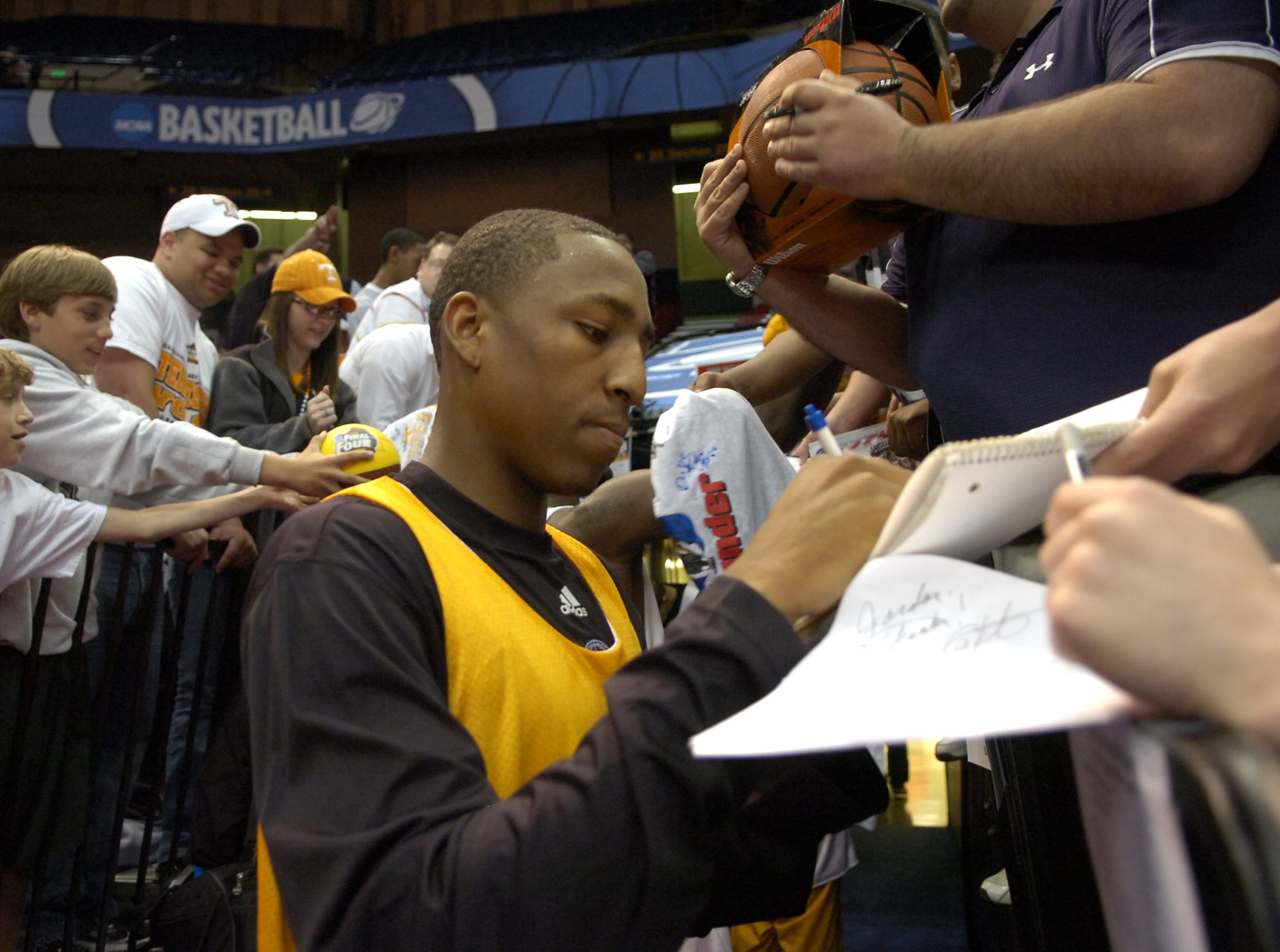 Tennessee's JaJuan Smith signs autographs for fans during a day of practice and press conferences to start the first round of the 2008 NCAA Tournament in Birmingham, Alabama on Thursday. Tennessee will face American University at 12:15EST on Friday.