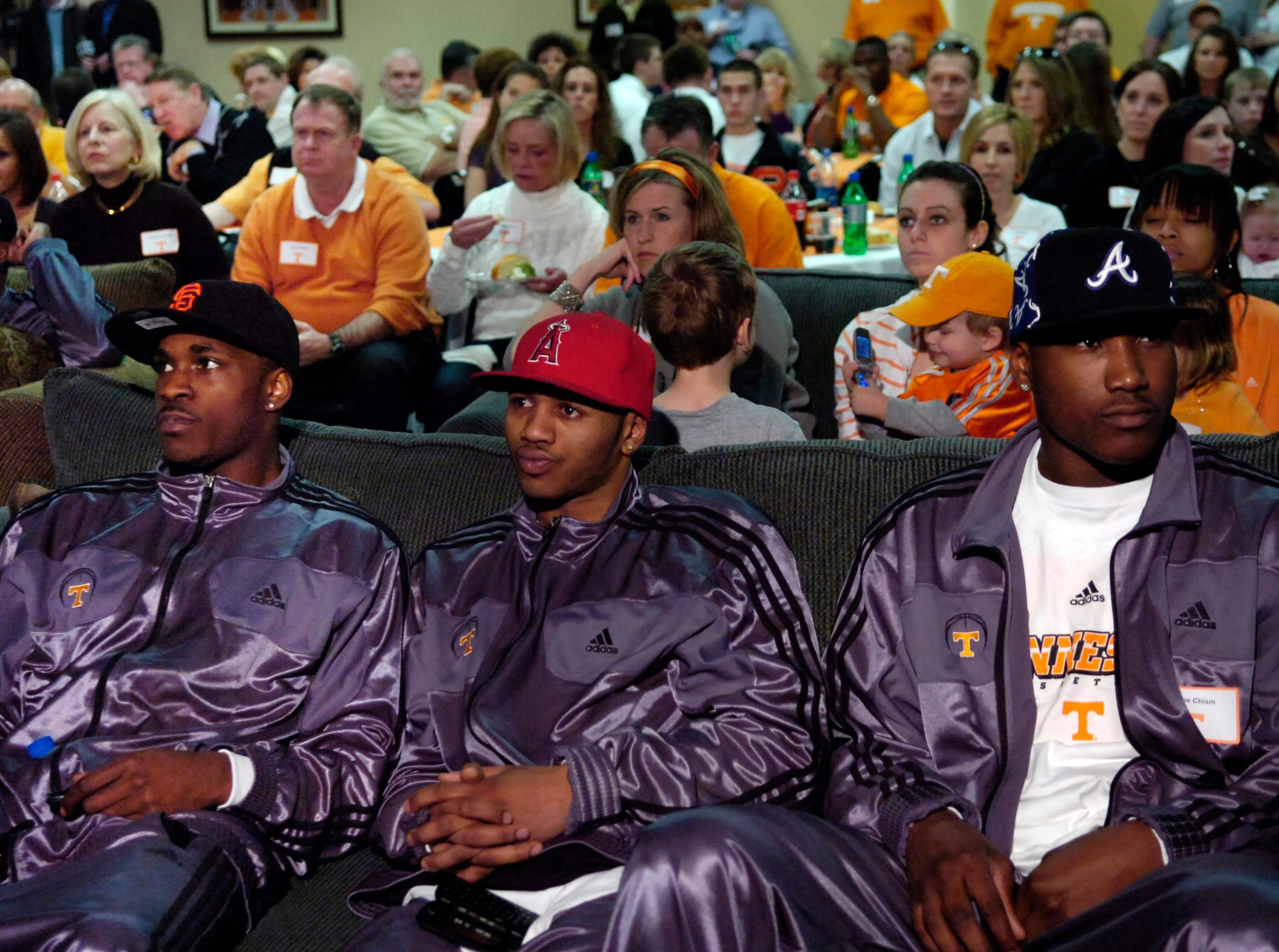 From left, Ramar Smith, Josh Tabb, and Wayne Chism remain emotionless as the number one seeds for the 2007 NCAA tournament was announced and did not include Tennessee. Fourth-ranked Tennessee received a No. 2 seed in the East Region of the NCAA men's basketball tournament as the team watched the results in the Ray Mear's Room at Thompson-Boling Arena Sunday.