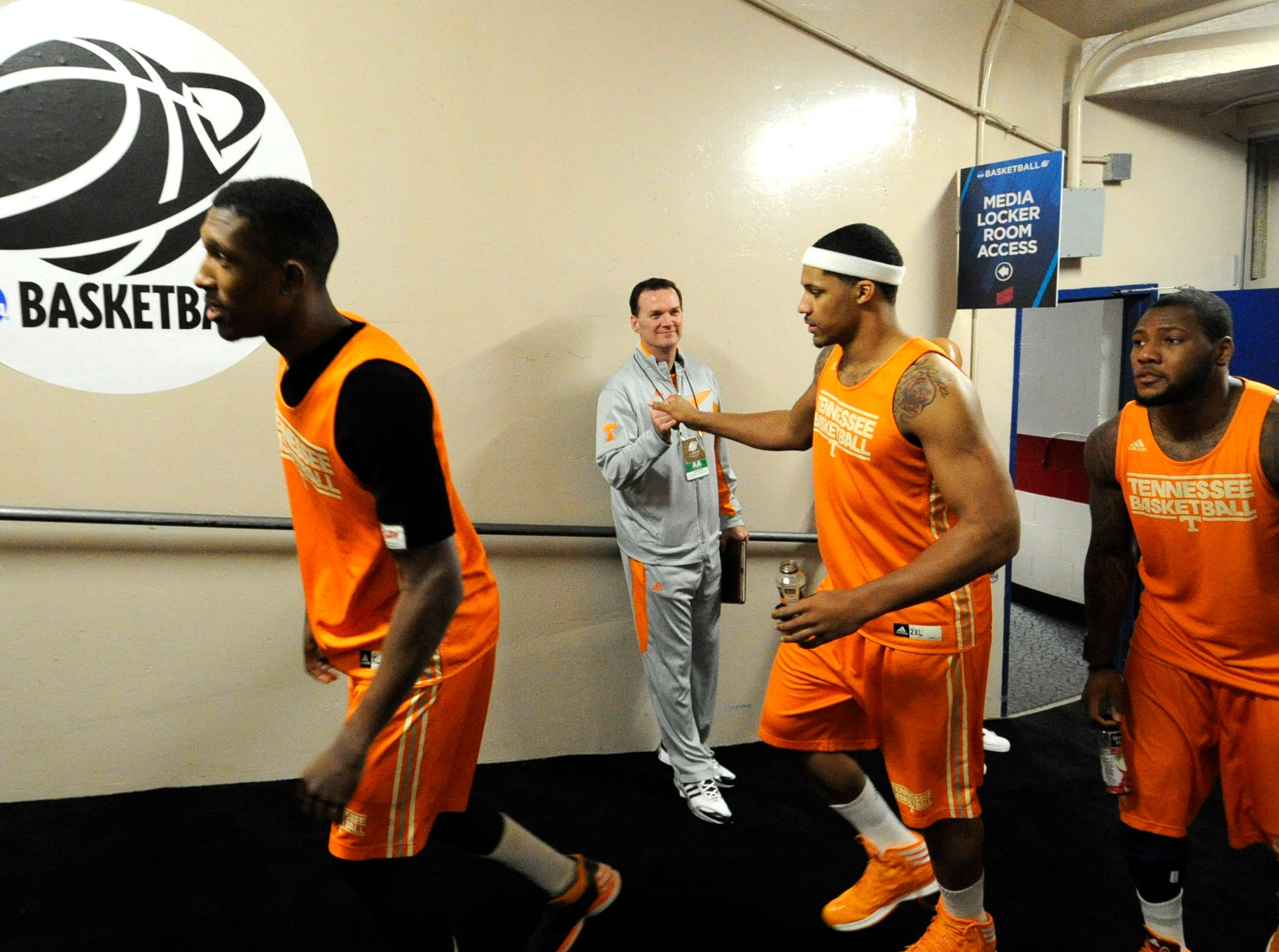 Tennessee guard Josh Richardson (1), Tennessee forward Jarnell Stokes (5), and Tennessee forward Jeronne Maymon (34), from left, emerge from the locker room for a press conference before an NCAA tournament first round game against Iowa at the University of Dayton Arena in Dayton, Ohio on Tuesday, March 18, 2014.