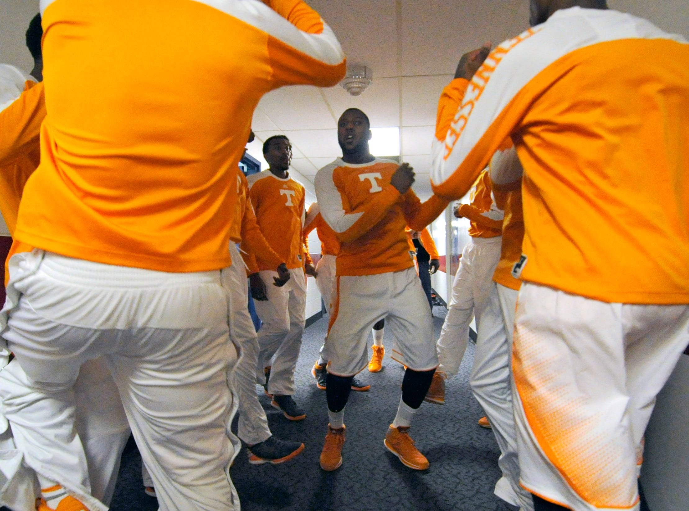 Tennessee forward Jeronne Maymon (34), center, rallies with his teammates in the locker room hallway before their NCAA tournament First Four play-in game against Iowa at the University of Dayton Arena in Dayton, Ohio on Wednesday, March 19, 2014.