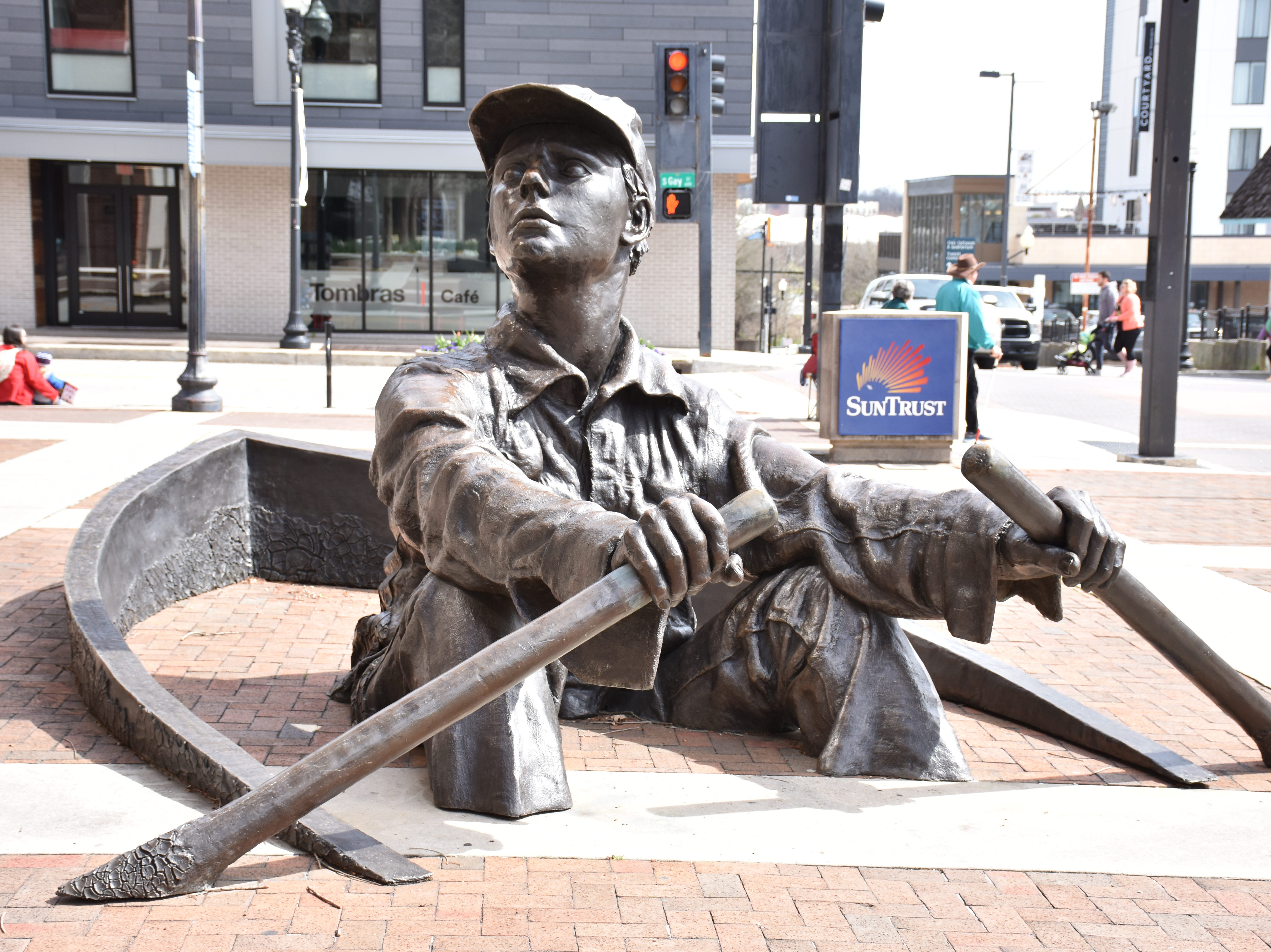 A giant bronze oarsman appears to paddle a boat that's half-submerged in the sidewalk at the corner of Church and Gay streets in downtown Knoxville. Sculpted by David L. Phelps in 1988, the statue is a popular spot for photos.