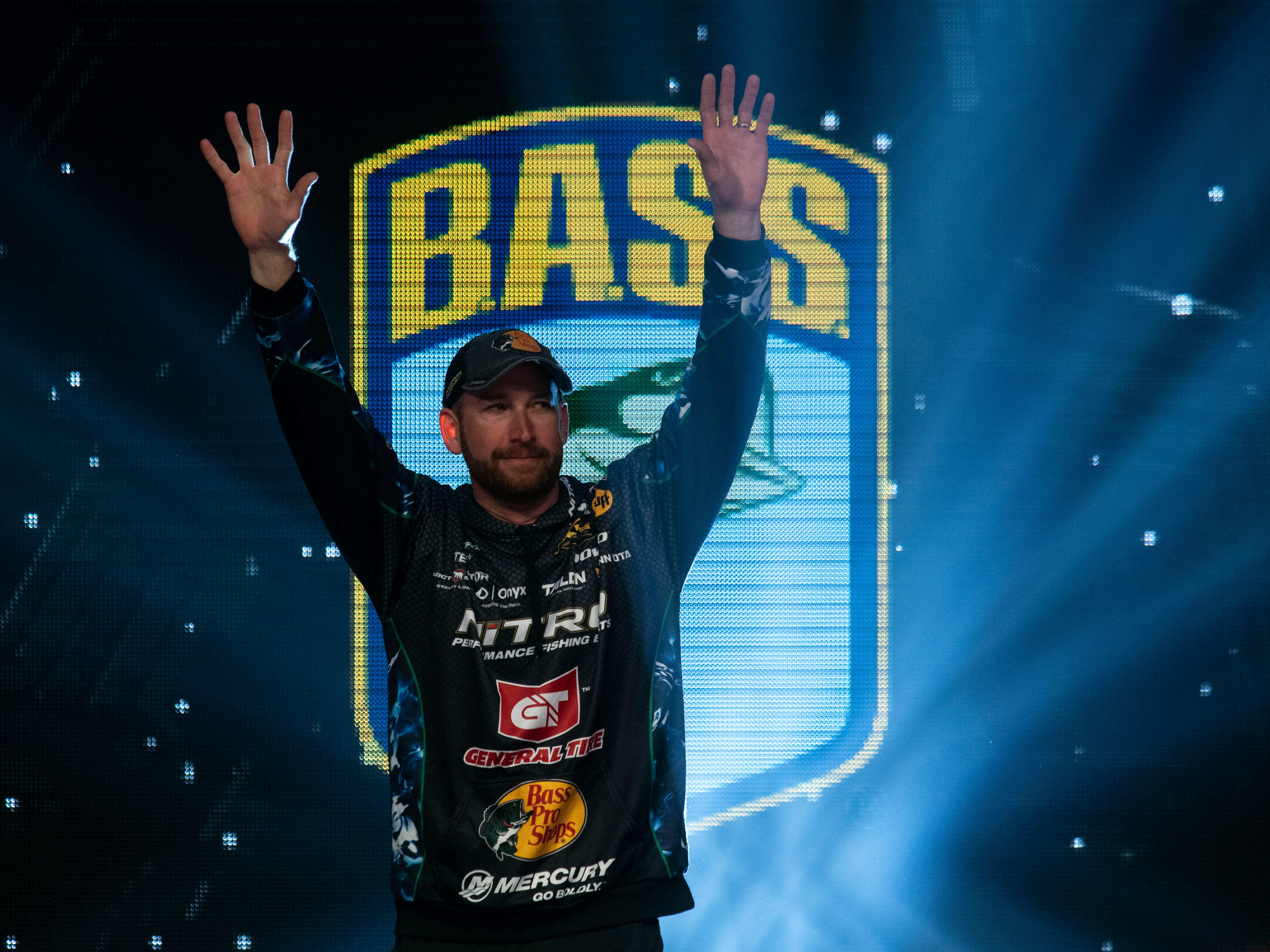 Ott DeFoe waves as he is introduced to the crowd in the final weigh-in of the Bassmaster Classic at Thompson-Boling Arena on Sunday, March 17, 2019.