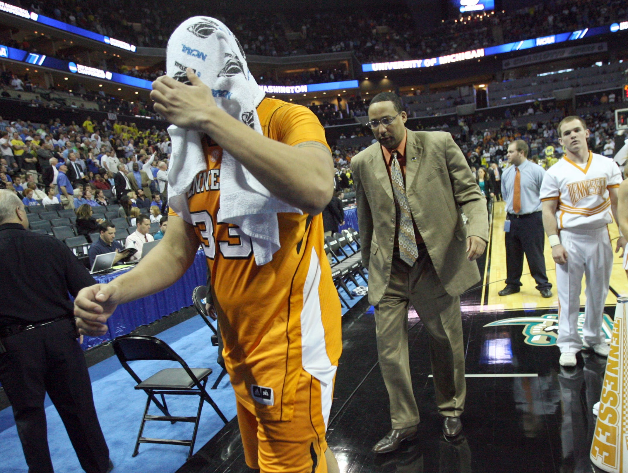 Tennessee center Brian Williams walks off the court after the Vols lost 75-45 to the Michigan Wolverines during the second round of the NCAA Tournament at Time Warner Cable Arena in Charlotte, N.C. Friday, March 18, 2011.  Williams scored two points for the Vols with two steals during the game.