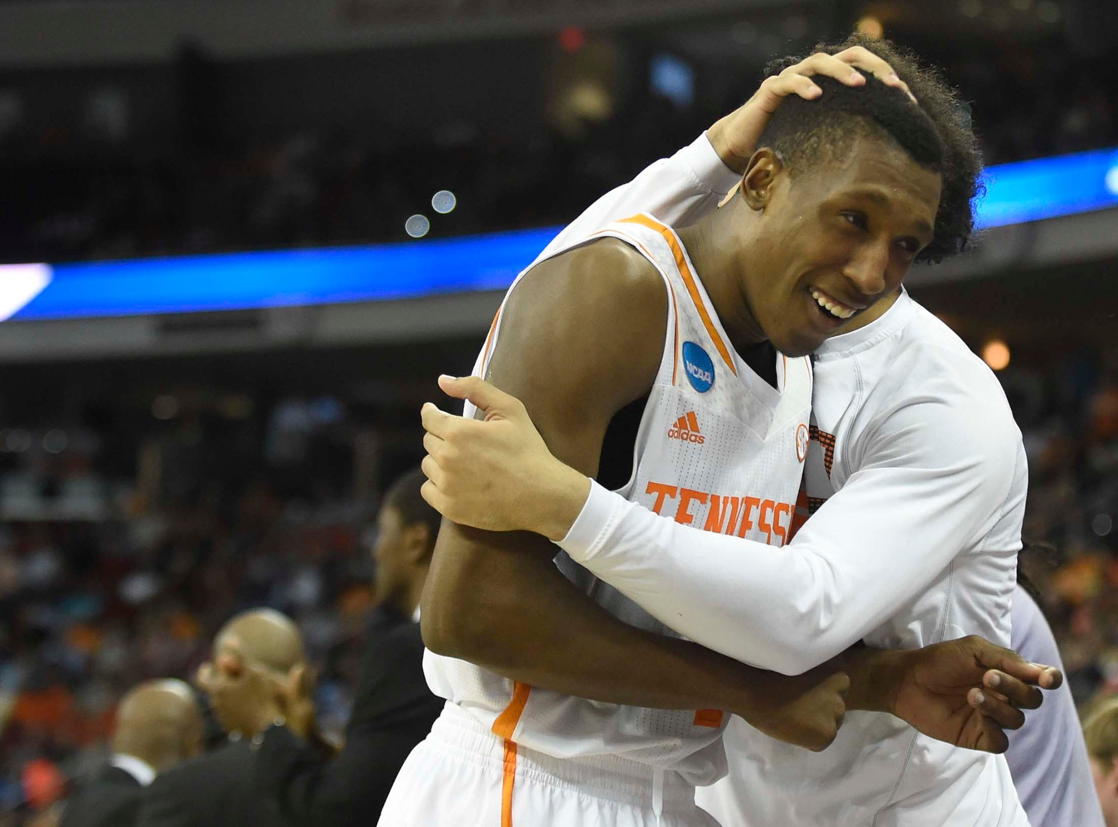 Tennessee guard Josh Richardson gets a hug from teammate Tennessee guard Quinton Chievous after Tennessee secured a Sweet Sixteen berth by defeating Mercer 83-63 in a third-round NCAA tournament game at the PNC Arena in Raleigh, N.C. on Sunday, March 23, 2014.