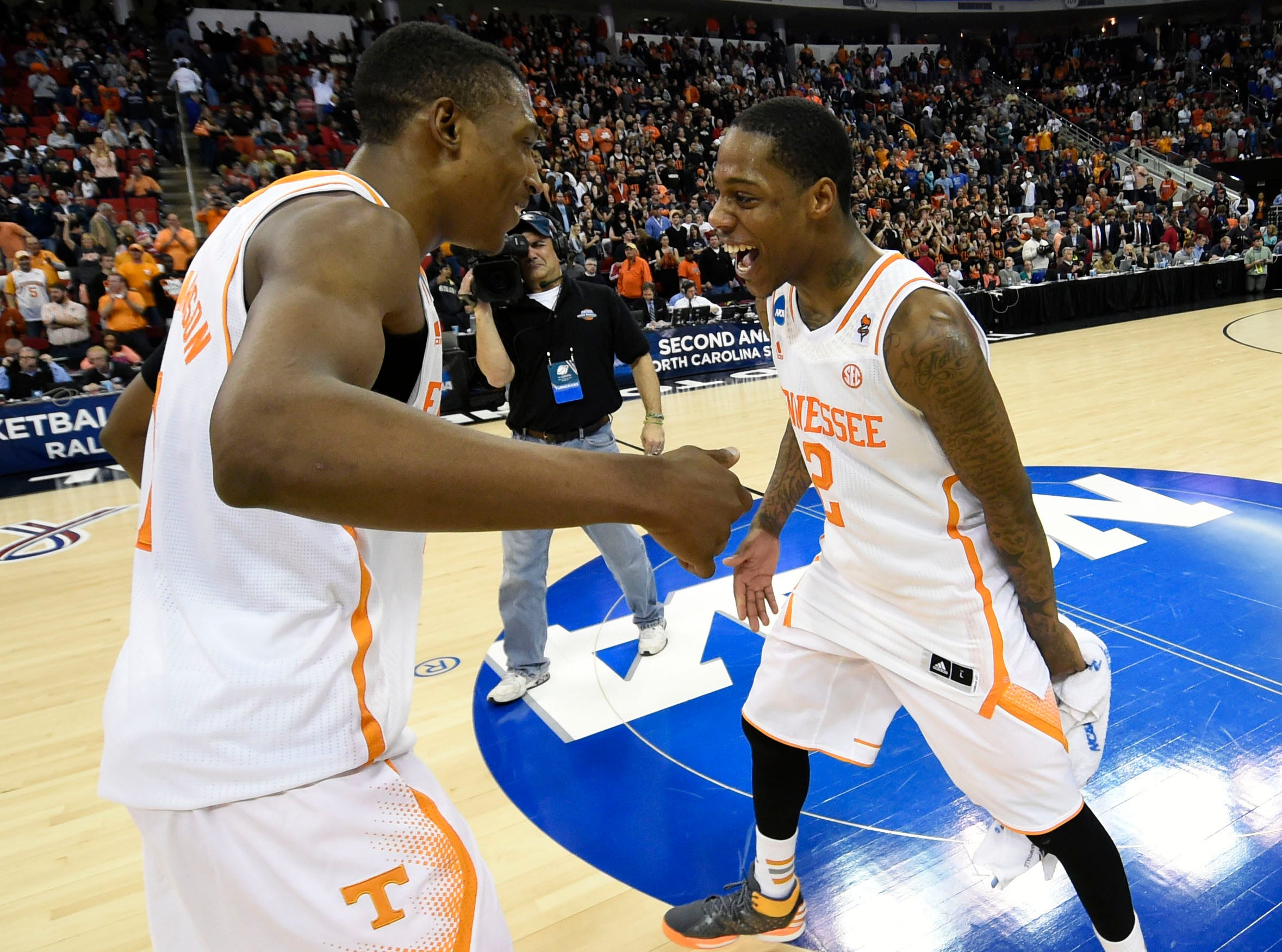 Tennessee guard Josh Richardson (1) and Tennessee guard Antonio Barton (2), from left, celebrate after securing a Sweet Sixteen berth by defeating Mercer 83-63 in a third-round NCAA tournament game at the PNC Arena in Raleigh, N.C. on Sunday, March 23, 2014.
