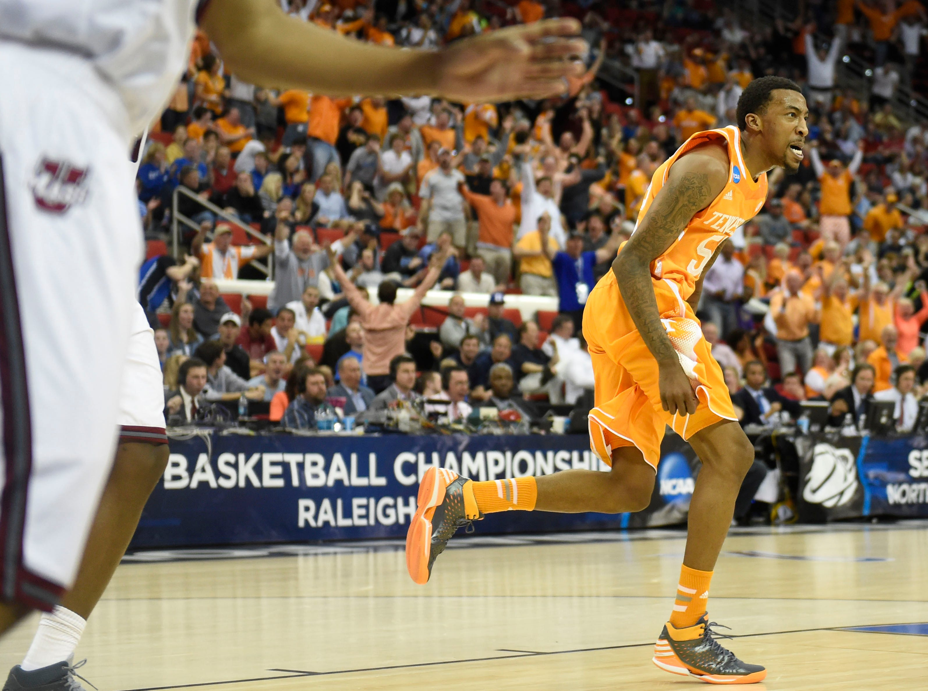 Tennessee guard Jordan McRae (52) reacts after hitting a slam dunk against Massachusetts during the first half of an NCAA tournament game at the PNC Arena in Raleigh, N.C. on Friday, March 21, 2014.