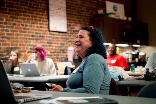 Dana McAllister, owner of Bead Chick Jewelry, shares a laugh during an Etsy Craft Entrepreneurship Program at the Knoxville Entrepreneur Center in downtown Knoxville, Tennessee on Saturday, March 16, 2019.