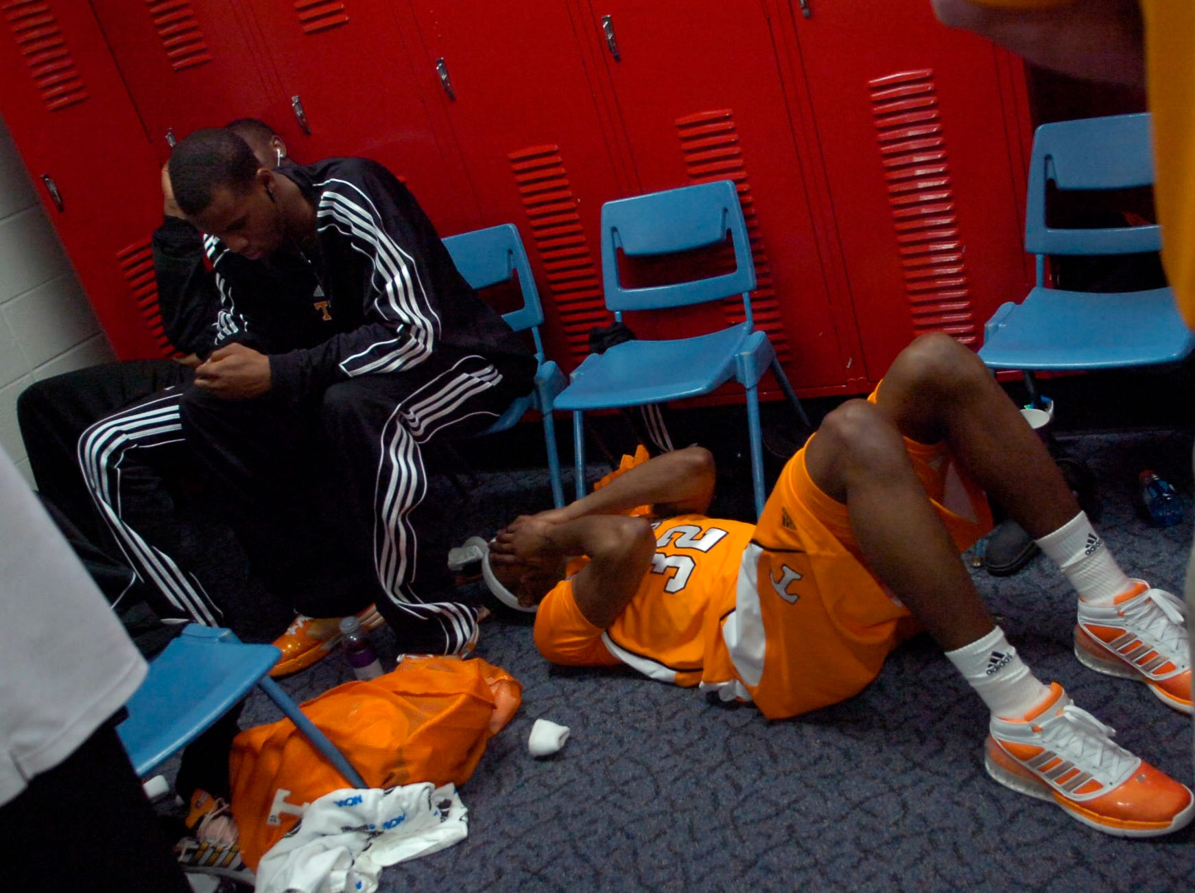 Tennessee's Scotty Hopson lies on the floor in the locker room beside teammate Renaldo Woolridge after the 77-75 loss to  Oklahoma State in the first round of the 2009 NCAA tournament in Dayton, OH on Friday, ending the Volunteers season.