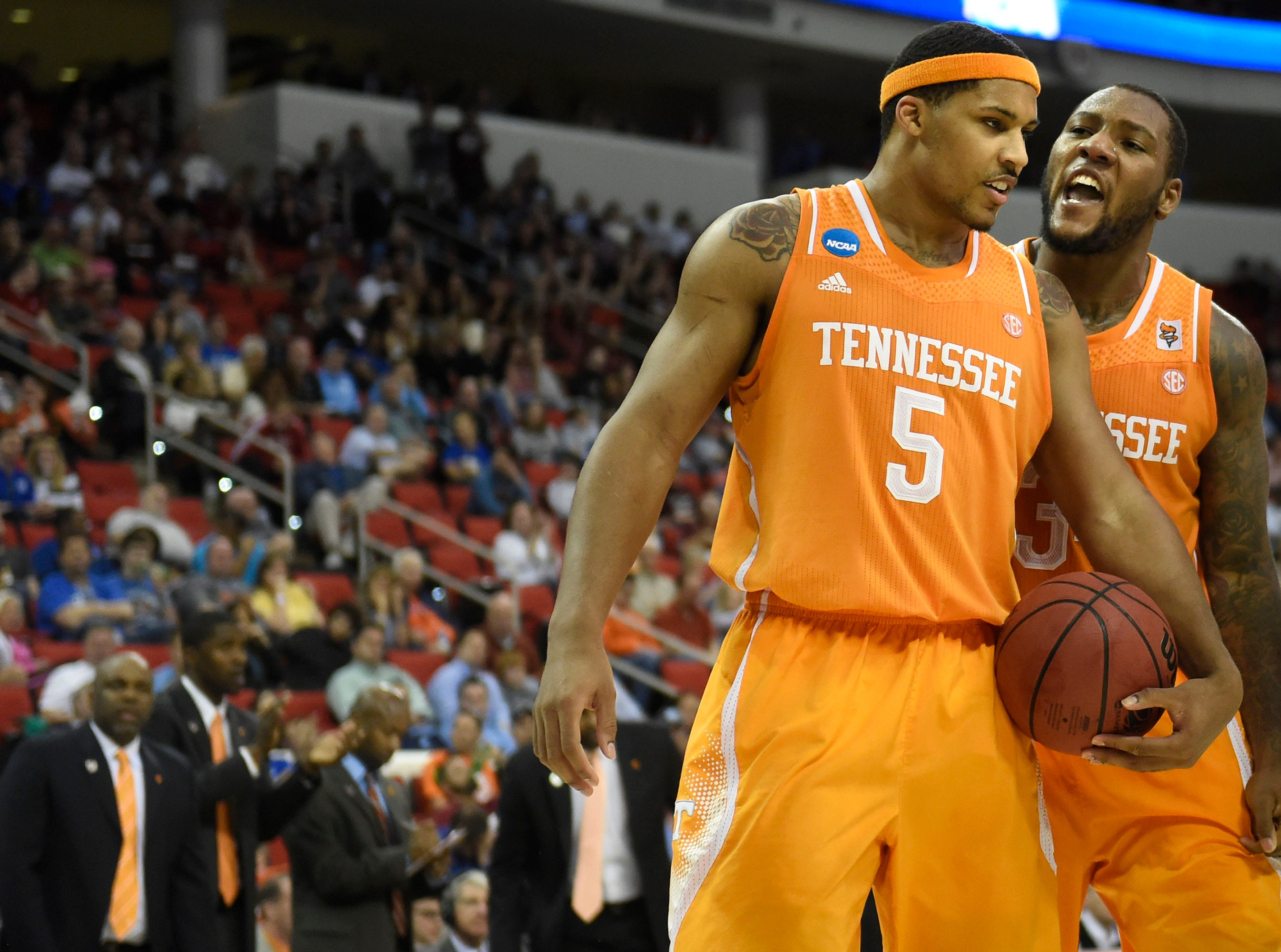Tennessee forward Jeronne Maymon (34), right, encourages Tennessee forward Jarnell Stokes (5) after Stokes made a shot against Massachusetts during the second half of an NCAA tournament game at the PNC Arena in Raleigh, N.C. on Friday, March 21, 2014. Tennessee won 86-67.