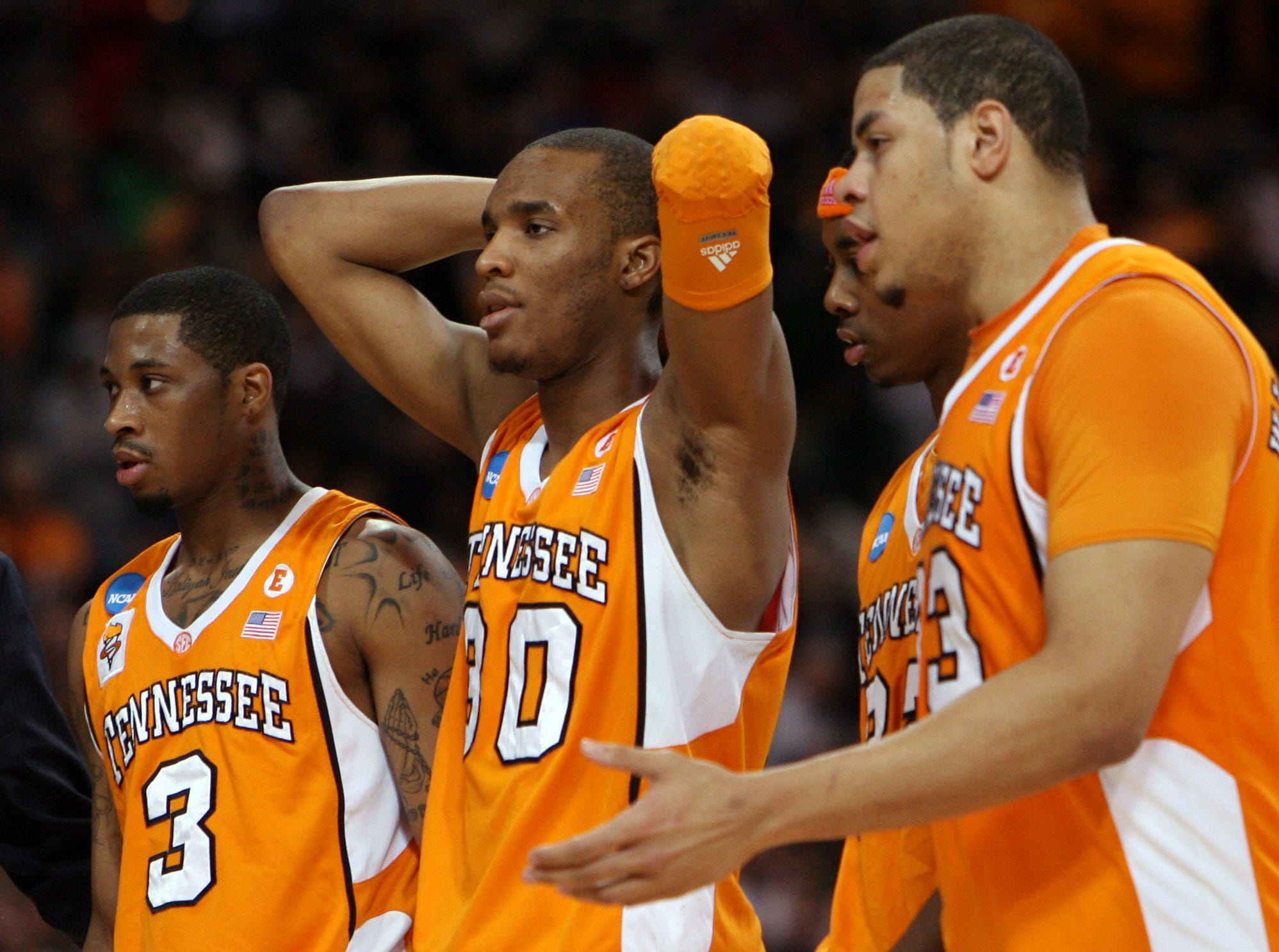 Tennessee's Bobby Maze, J.P. Prince, Scotty Hopson and Brian Williams walk to the bench after Prince was called with a foul against Michigan State in the final seconds of the NCAA tournament game at the Edward Jones Dome in St. Louis, Mo., Sunday, Mar. 28, 2010.