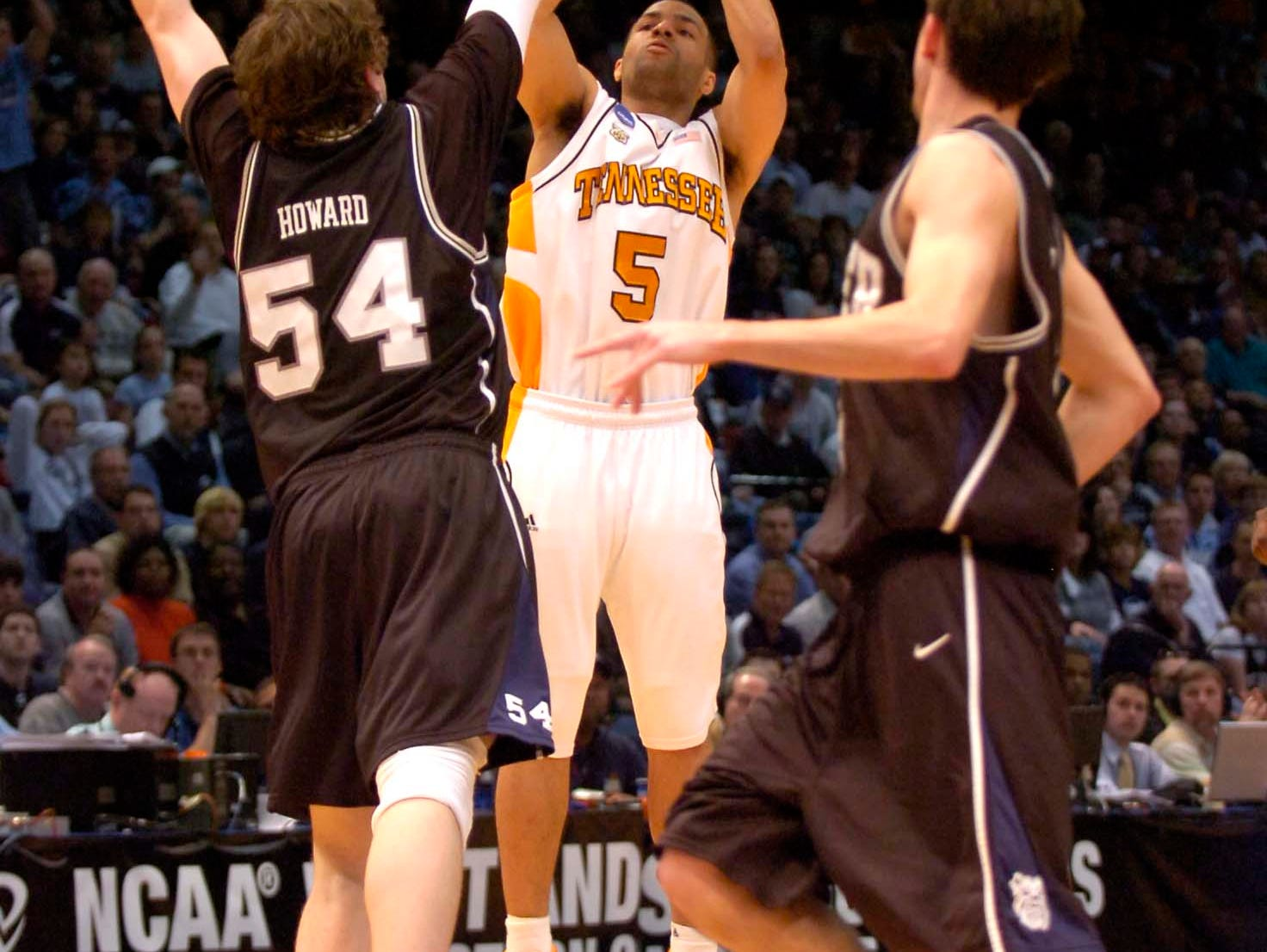 Tennessee's Chris Lofton shoots for three over Butler's Matt Howard at the Birmingham Jefferson Convention Center in Birmingham, Alabama during second round play in the 2008 NCAA Tournament on Sunday. Tennessee defeated Butler 76-71 and will advance to the Sweet Sixteen in Charlotte, NC next week.