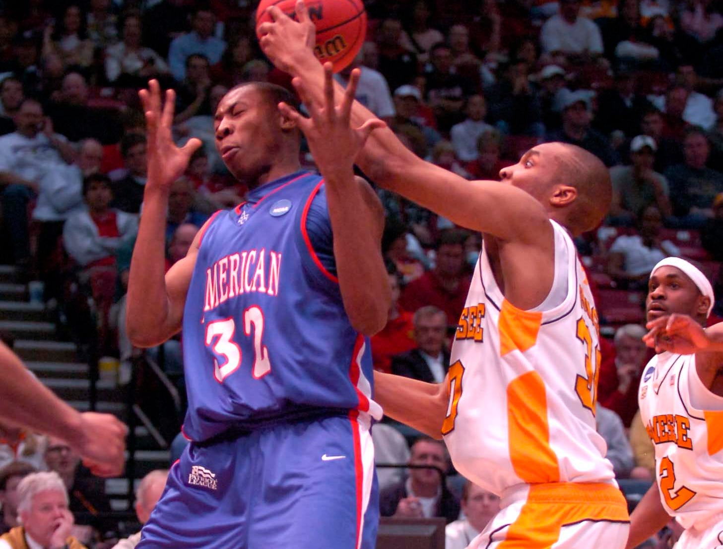 Tennessee's J.P. Prince knocks the ball away from American University's Cornelio Guibunda during first round competition of the 2008 NCAA Tournament in Birmingham on Friday. Tennessee won the game 72-57 and advance to play the winner of Butler vs. South Alabama.