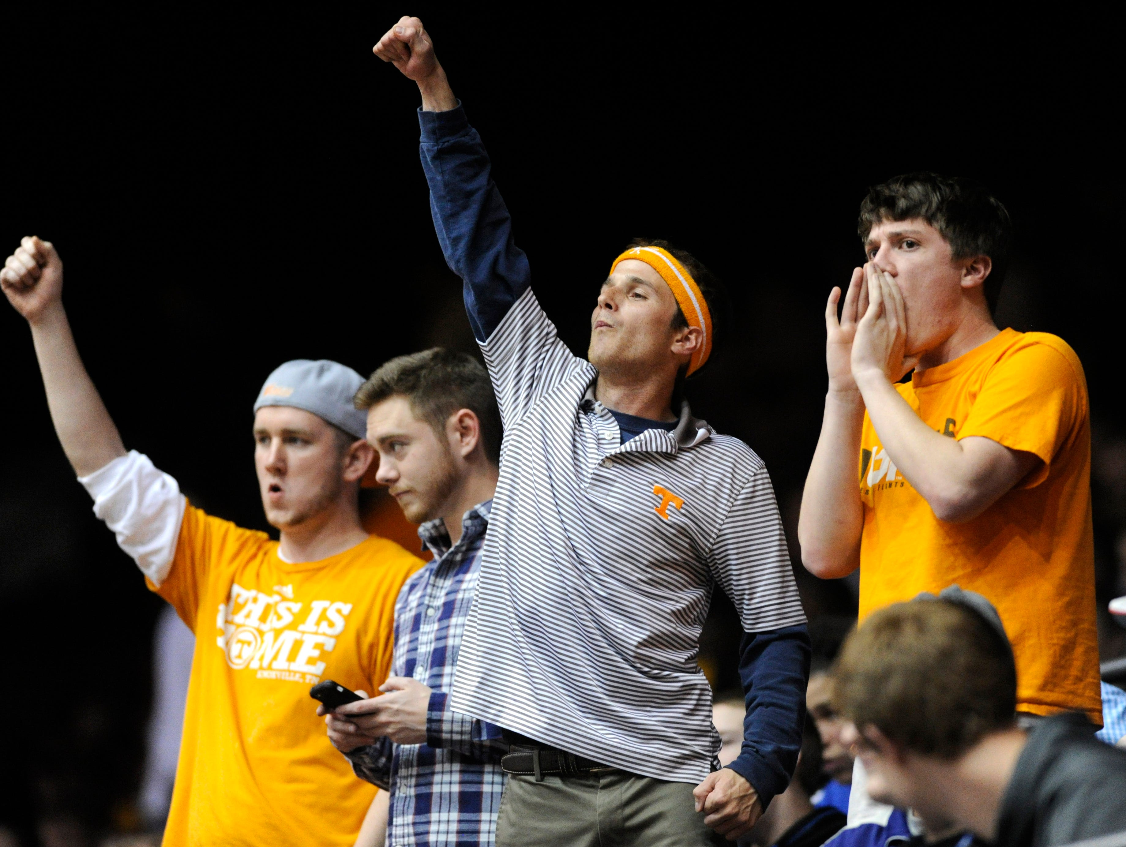 Tennessee fans cheer during the second half of an NCAA tournament First Four play-in game at the University of Dayton Arena in Dayton, Ohio on Wednesday, March 19, 2014. Tennessee won 78-65 in overtime.