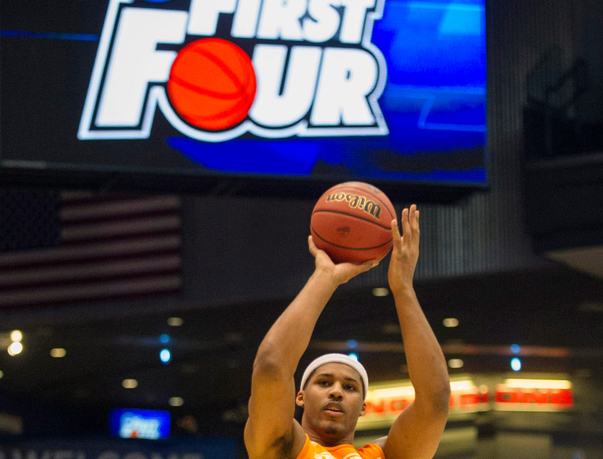 Tennessee forward Jarnell Stokes (5) practices shooting three-pointers while teammate Quinton Chievous (31) looks on during an open practice before Tennessee's NCAA tournament first round game against Iowa at the University of Dayton Arena in Dayton, Ohio on Tuesday, March 18, 2014.