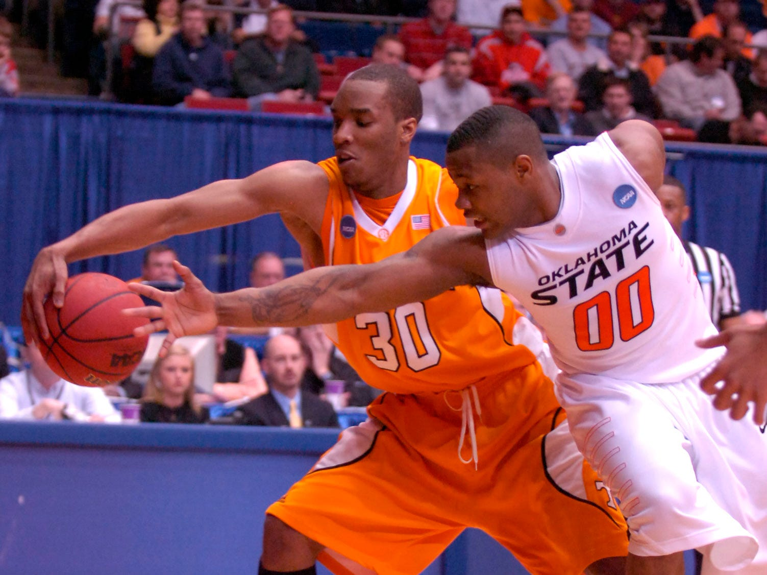 Tennessee's J.P. Prince grabs for a loose ball with Oklahoma State's Byron Eaton during the first round of the 2009 NCAA tournament in Dayton, OH on Friday. UT lost the game 77-75 ending their post season play.