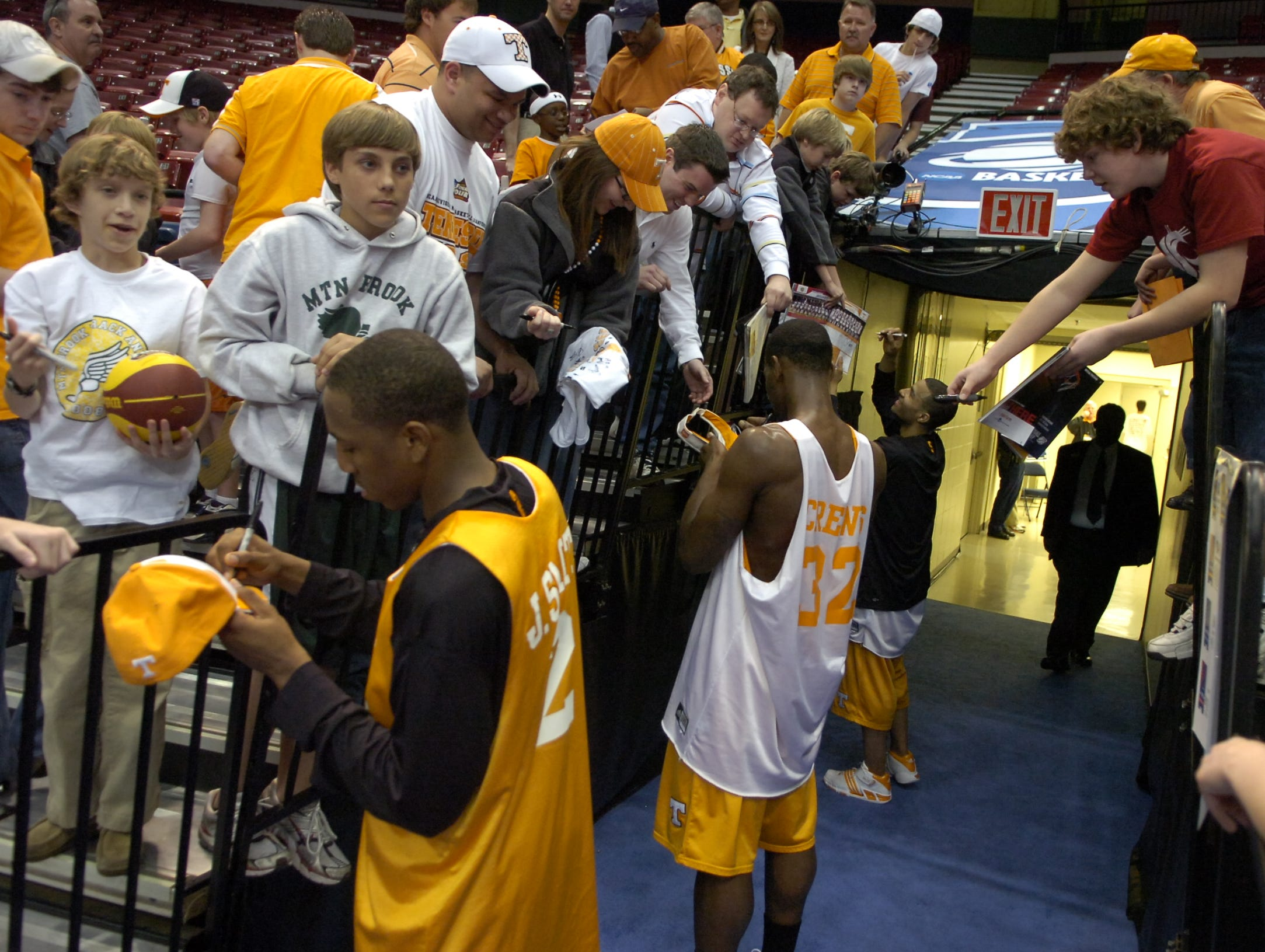 Tennessee's JaJuan Smith, Duke Crews and Chris Lofton sign autographs for fans during a day of practice and press conferences to start the first round of the 2008 NCAA Tournament in Birmingham, Alabama on Thursday. Tennessee will face American University at 12:15EST on Friday.