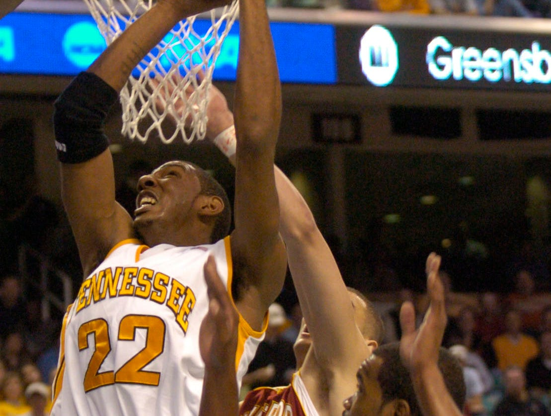 UT's Andre Patterson goes up to score two under pressure from Winthrop's James Shuler (0) and Craig Bradshaw (5) during a first round NCAA tournament game Thursday at the Greensboro Coliseum in Greensboro, N.C. The Vols won the game 63-61.2006