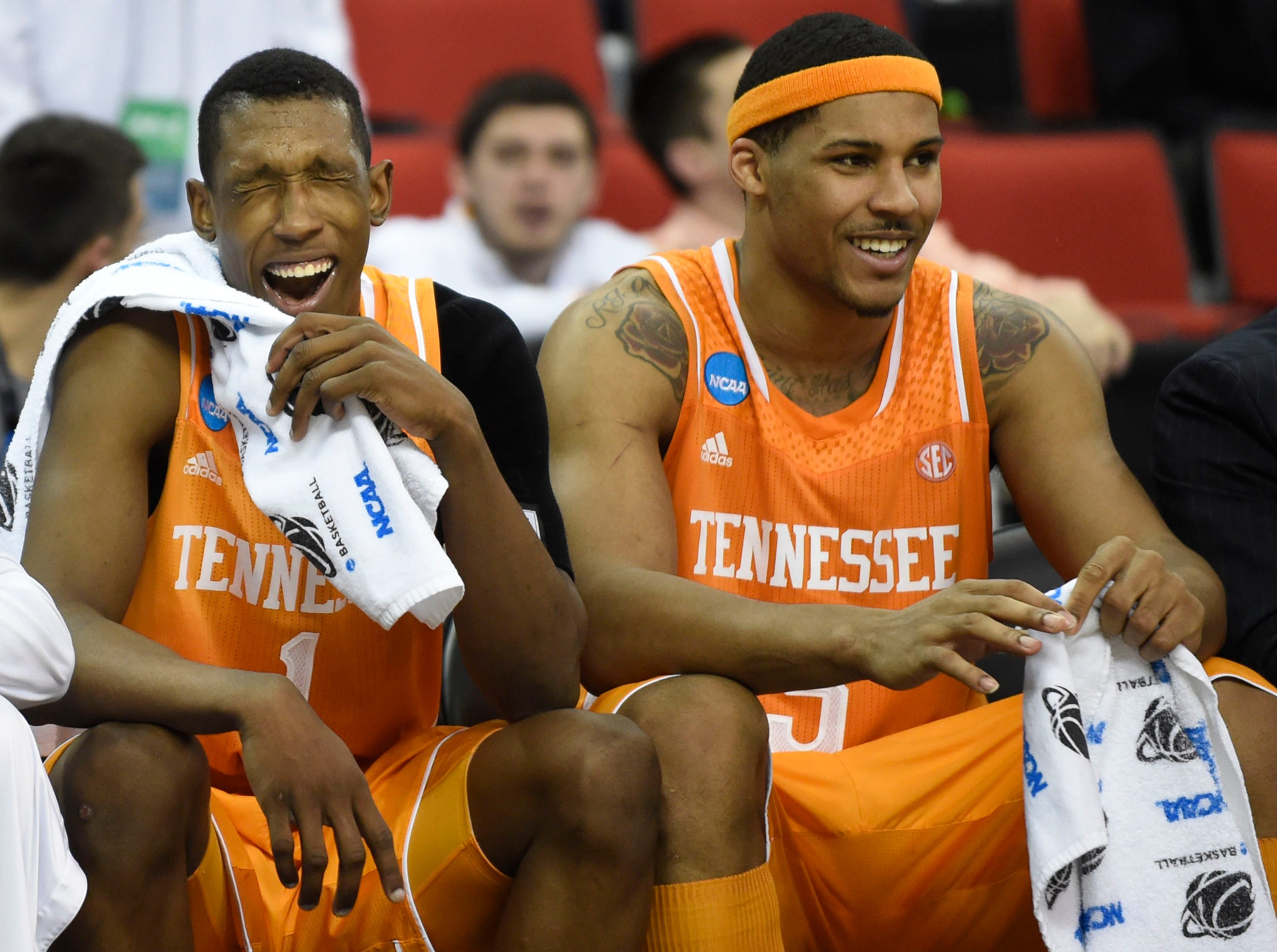 Tennessee guard Josh Richardson (1) and Tennessee forward Jarnell Stokes (5), from left, relax on the sideline during Tennessee's 86-67 victory over Massachusetts during the second half of an NCAA tournament game at the PNC Arena in Raleigh, N.C. on Friday, March 21, 2014.