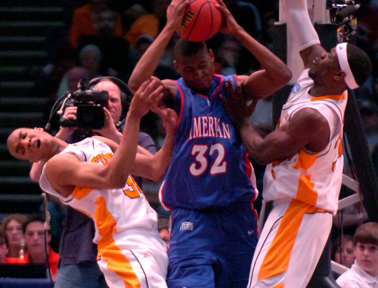 American University's Cornelio Guibunda tries to protect possession of the ball under pressure from Tennessee teammates J.P. Prince and Duke Crews during first round competition of the 2008 NCAA Tournament in Birmingham on Friday.