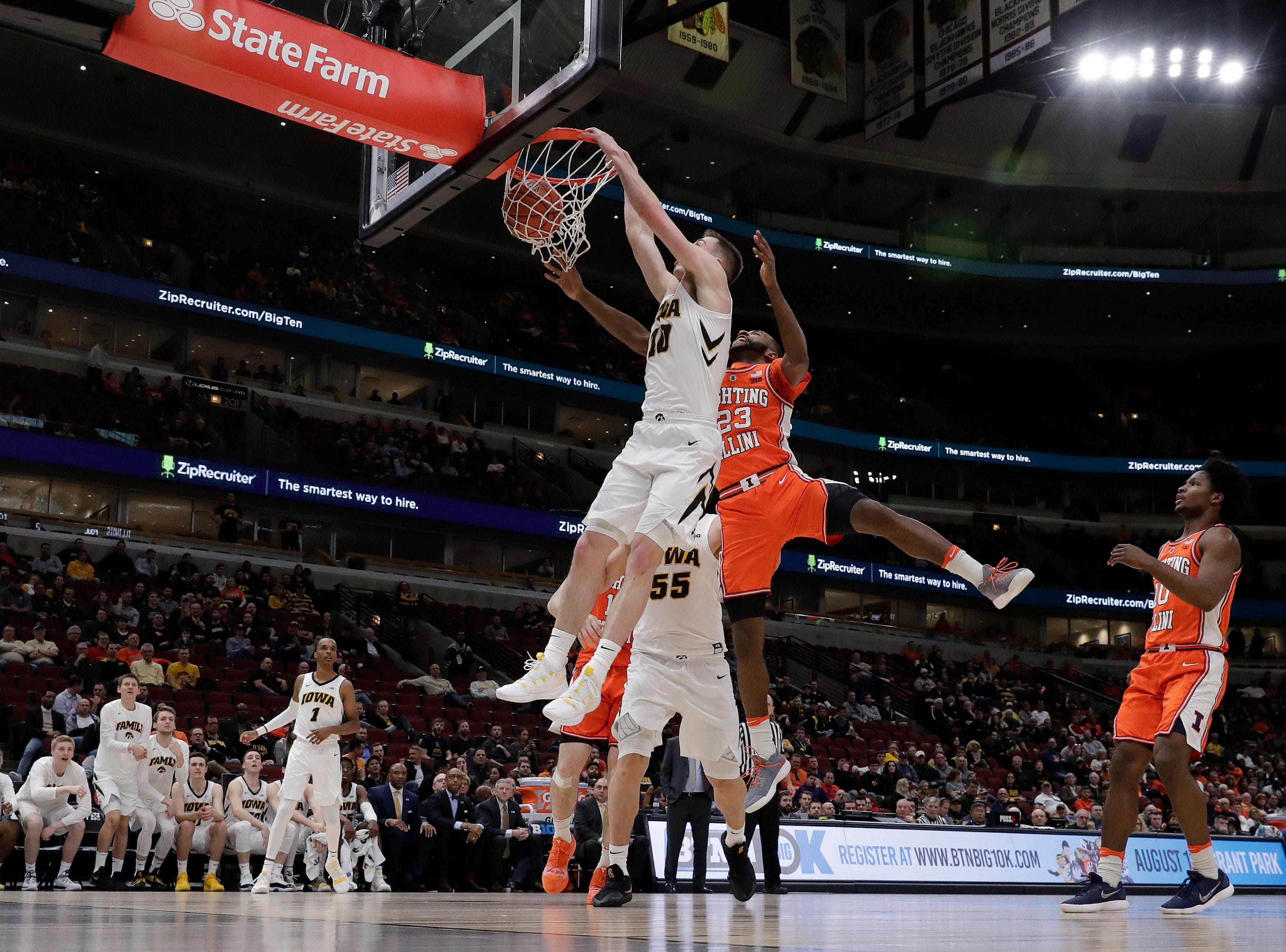Iowa's Joe Wieskamp (10) dunks against Illinois's Aaron Jordan (23) during the second half of an NCAA college basketball game in the second round of the Big Ten Conference tournament, Thursday, March 14, 2019, in Chicago.